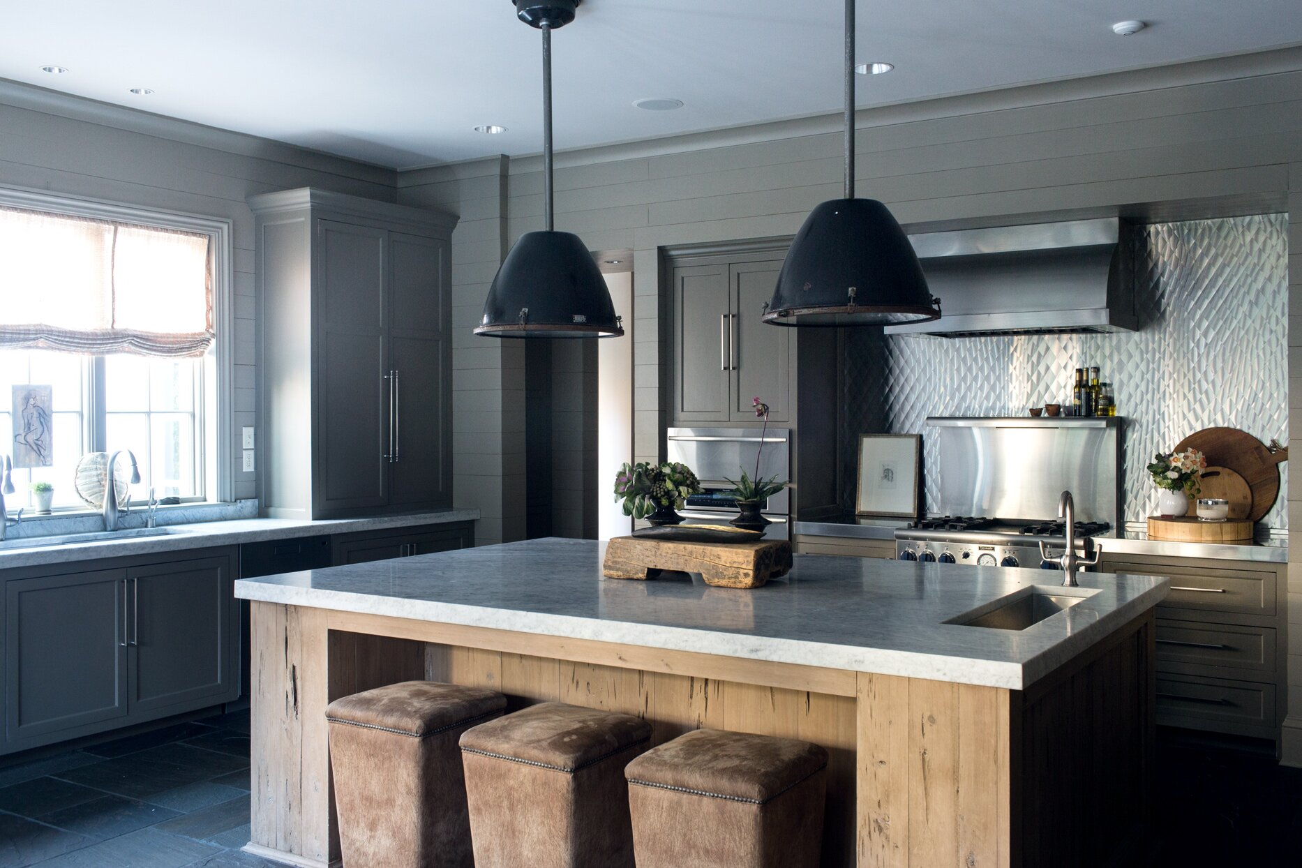 grey kitchen with wood island