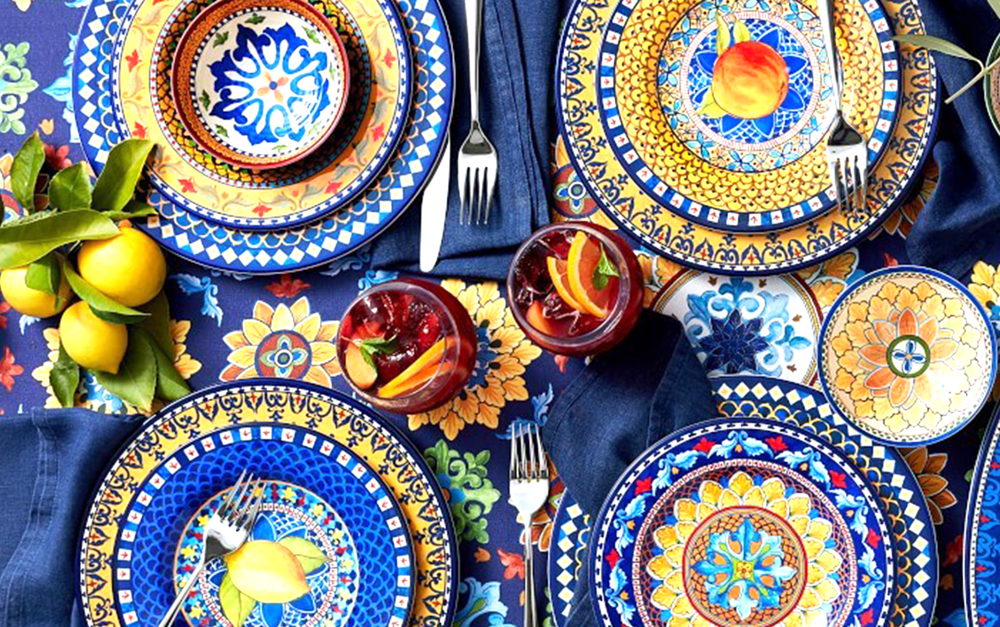 Overhead shot of a set dining table with blue patterned plates and linens