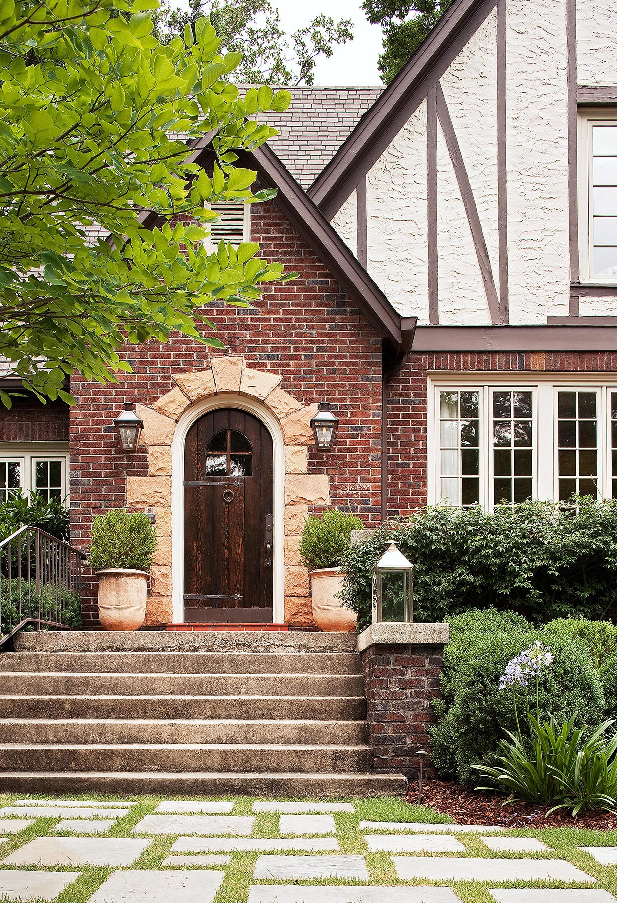 arched doorway with stone trim on tudor home