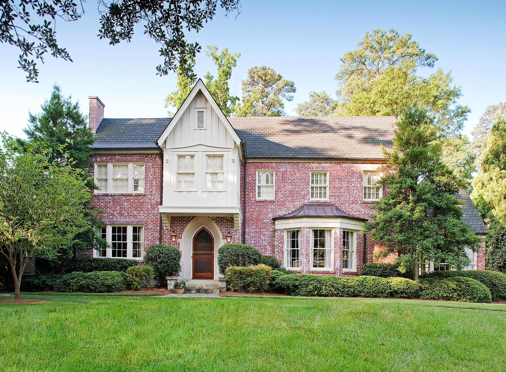 tudor- and english country-inspired brick home