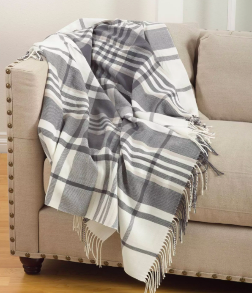 gray and white plaid blanket on a beige couch