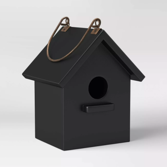 black wood birdhouse on a white background