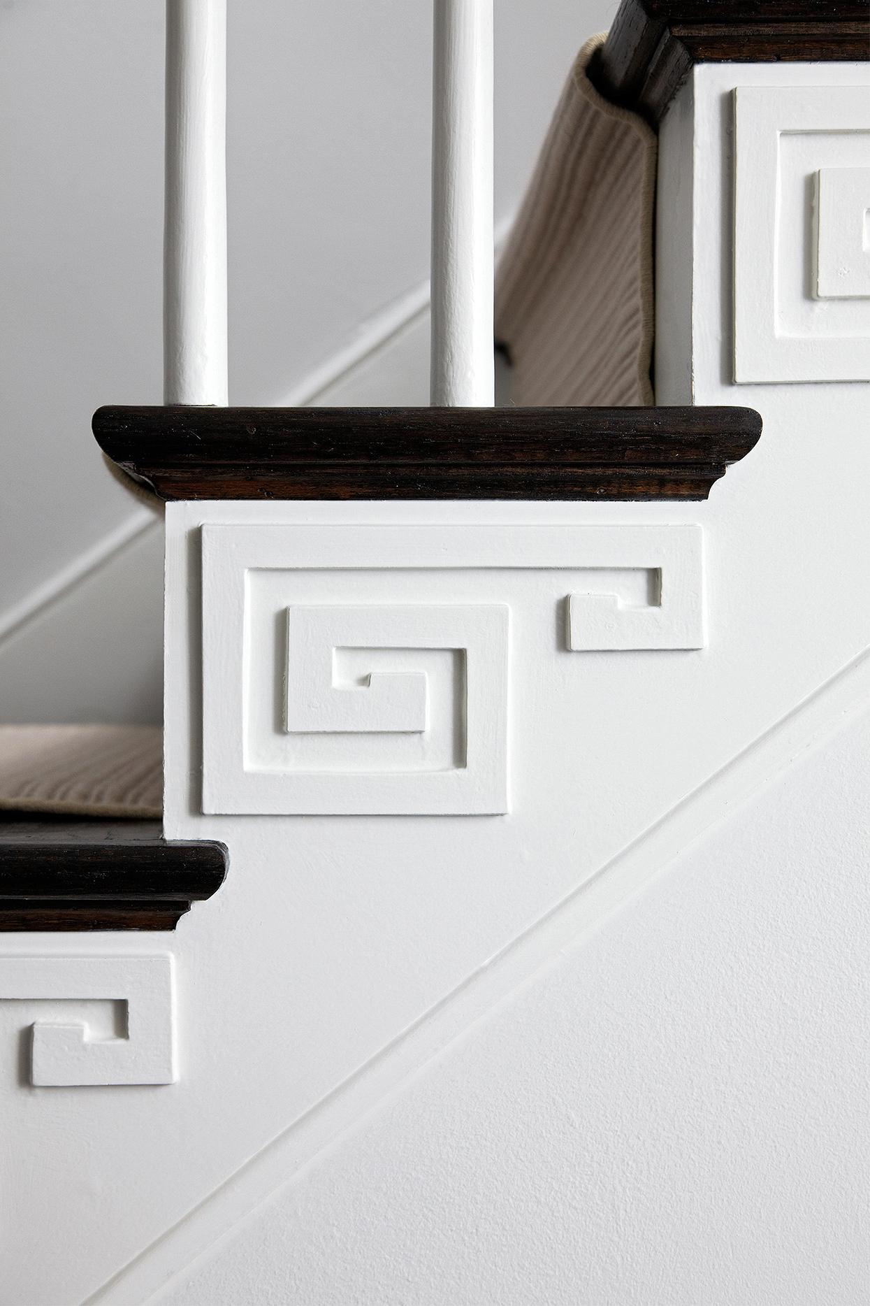 detail of staircase with decorative brackets on skirtboard