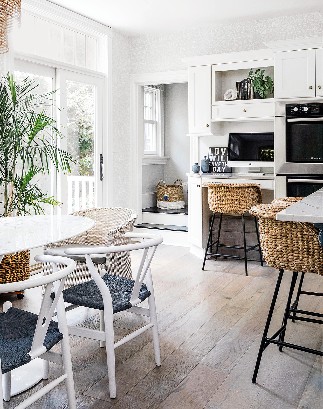 seagrass stools and white shaker kitchen cabinets