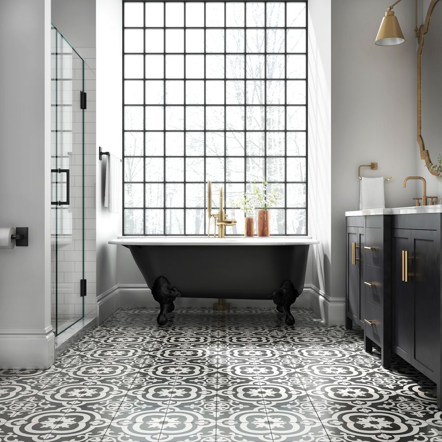 black and white floor tile in bathroom with clawfoot tub