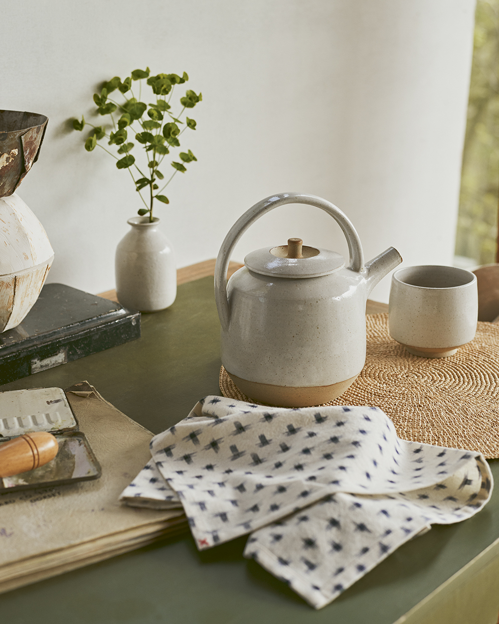 teapot and kitchen towel on counter