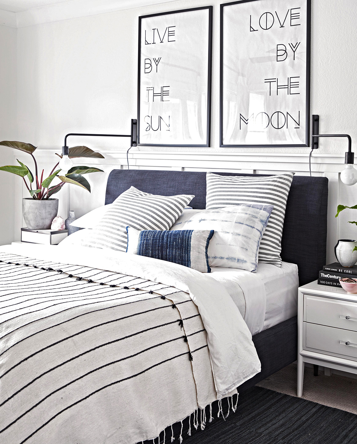 white bedroom with striped navy accents