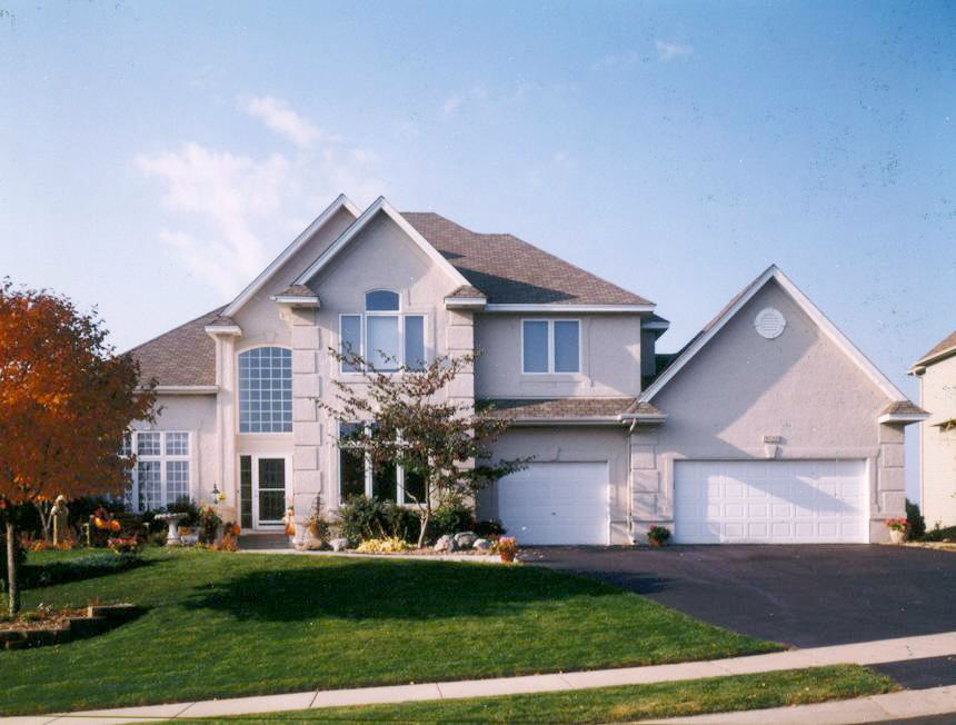 Gray house with white garage doors