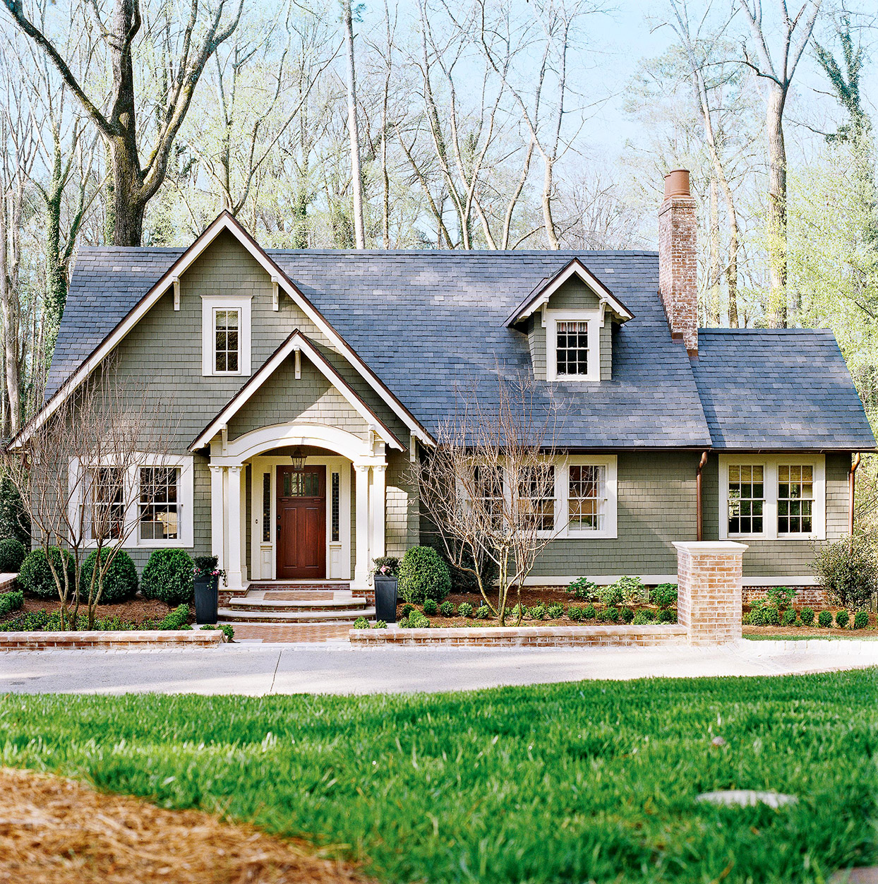 Gray house with white trim and red door