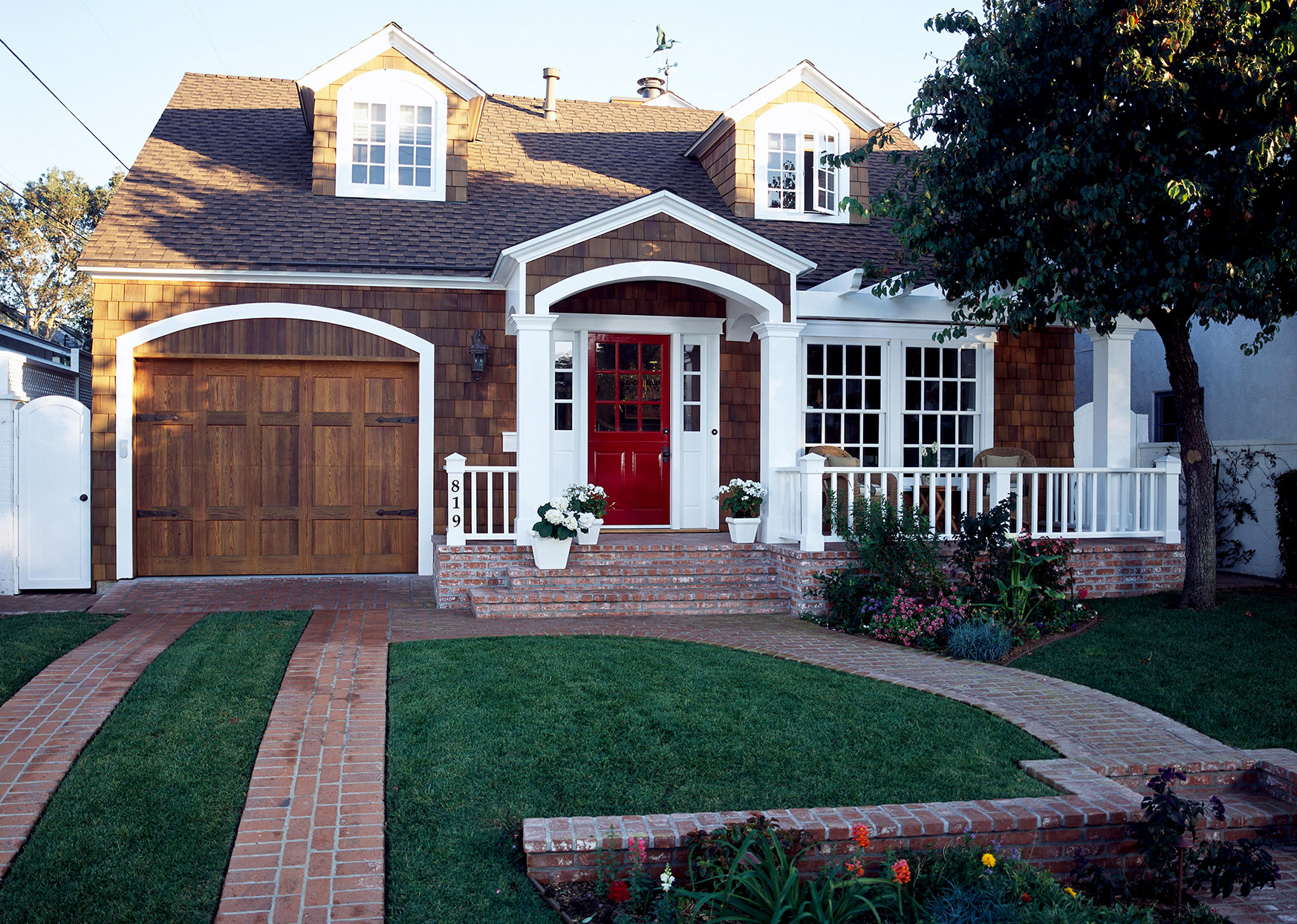 Wooden house with white trim and red door
