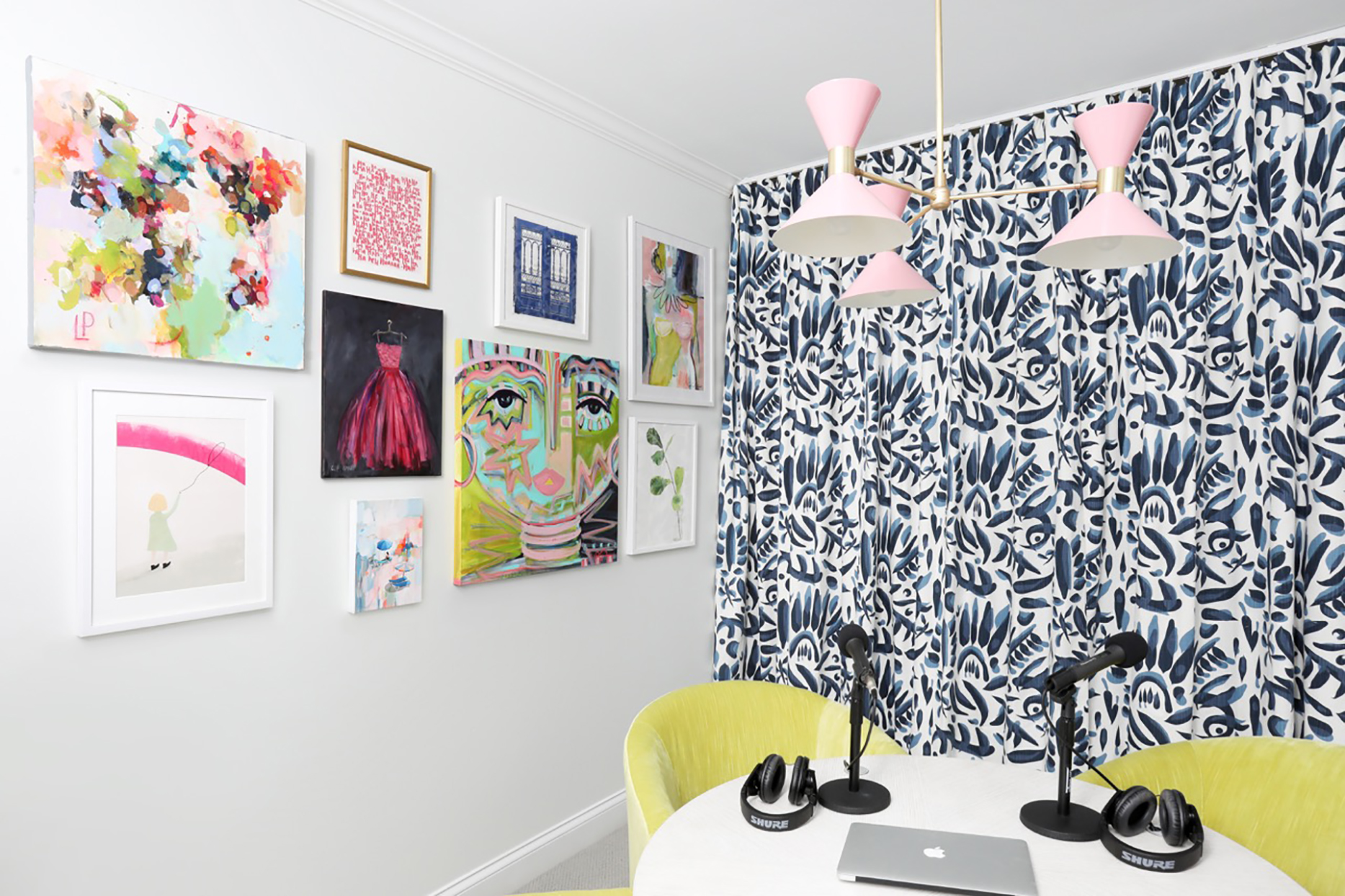 podcast studio with colorful gallery wall and patterned wallpaper