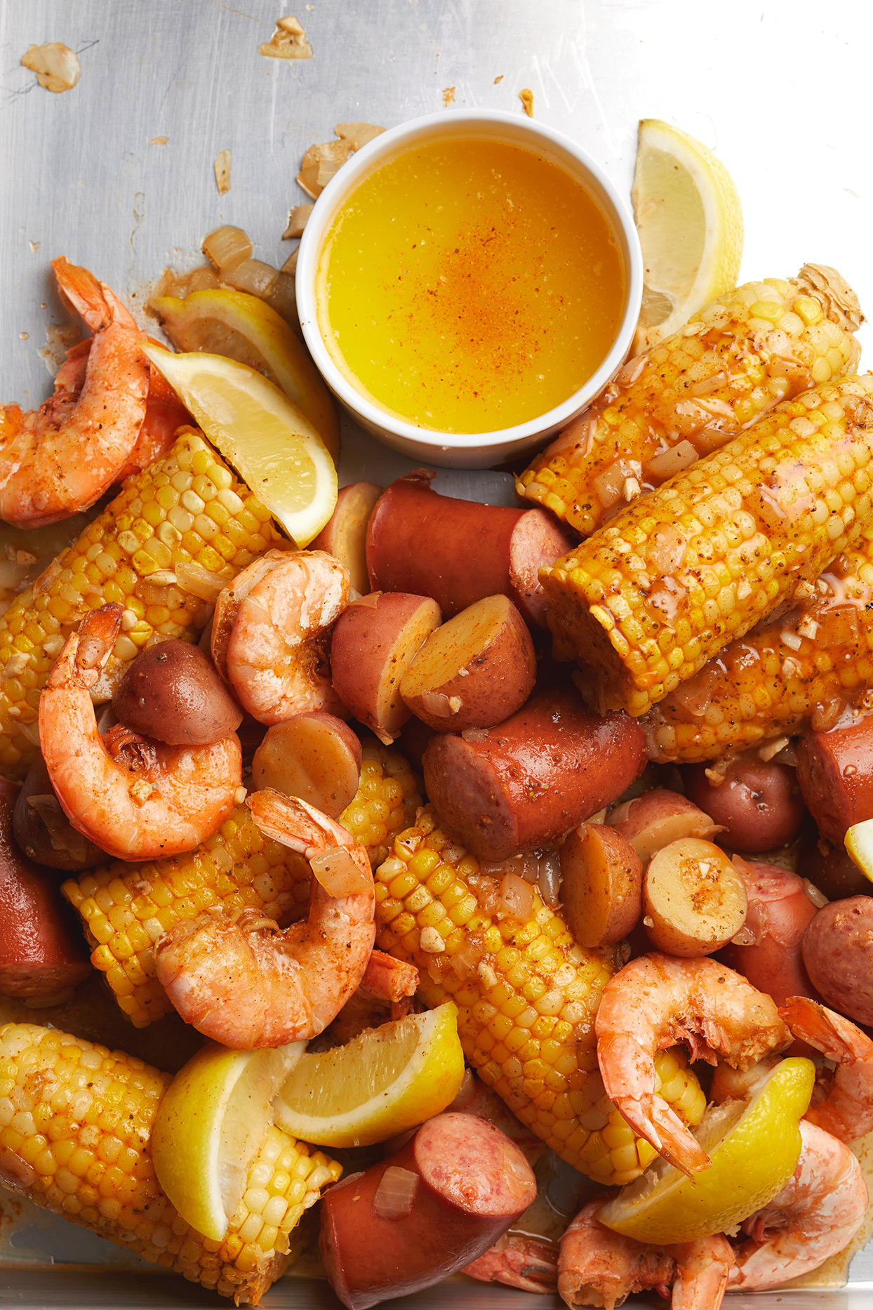 Low-Country Shrimp Boil with potatoes and corn on plate