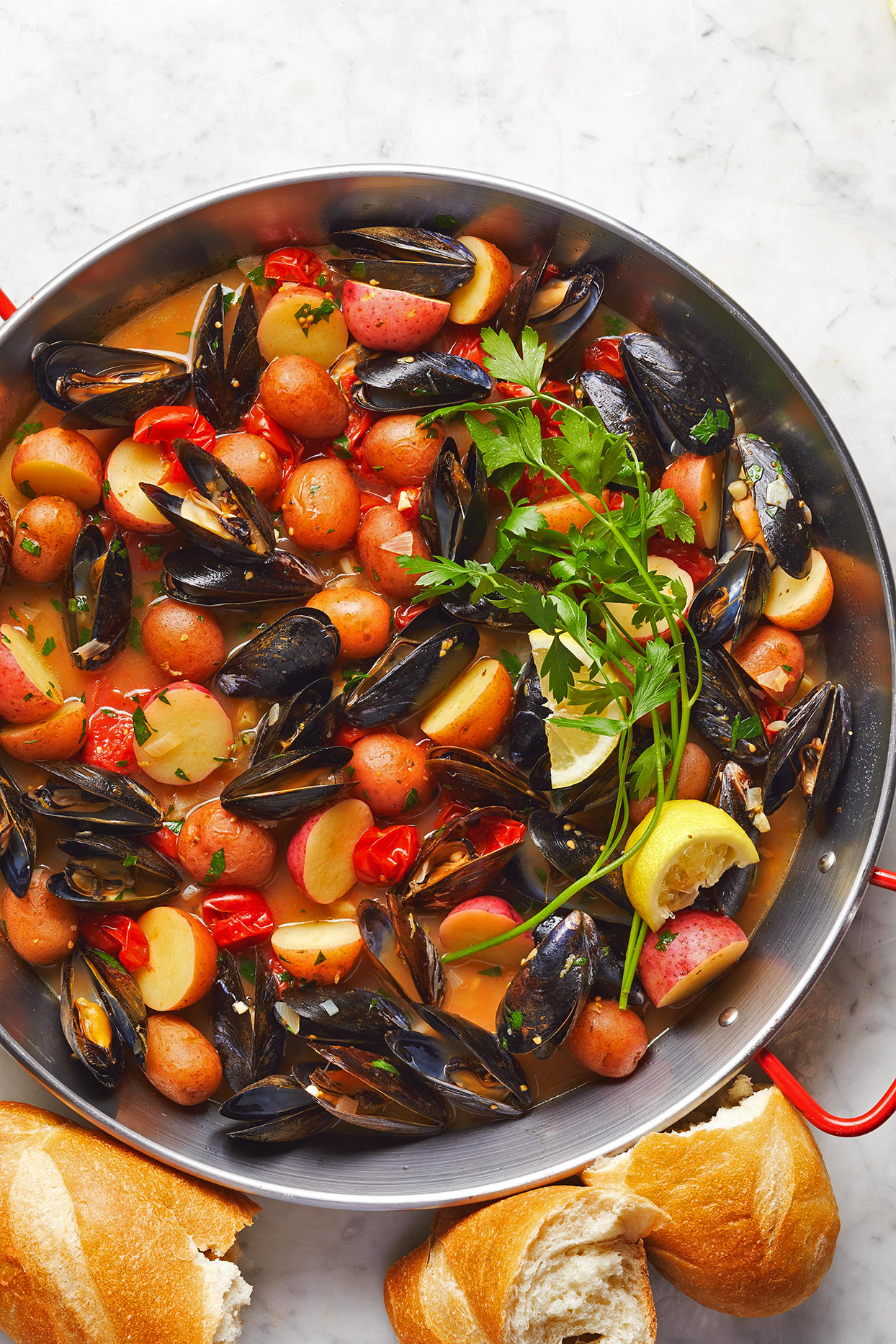 Lemony Mussels with Cherry Tomatoes and Potatoes in pan