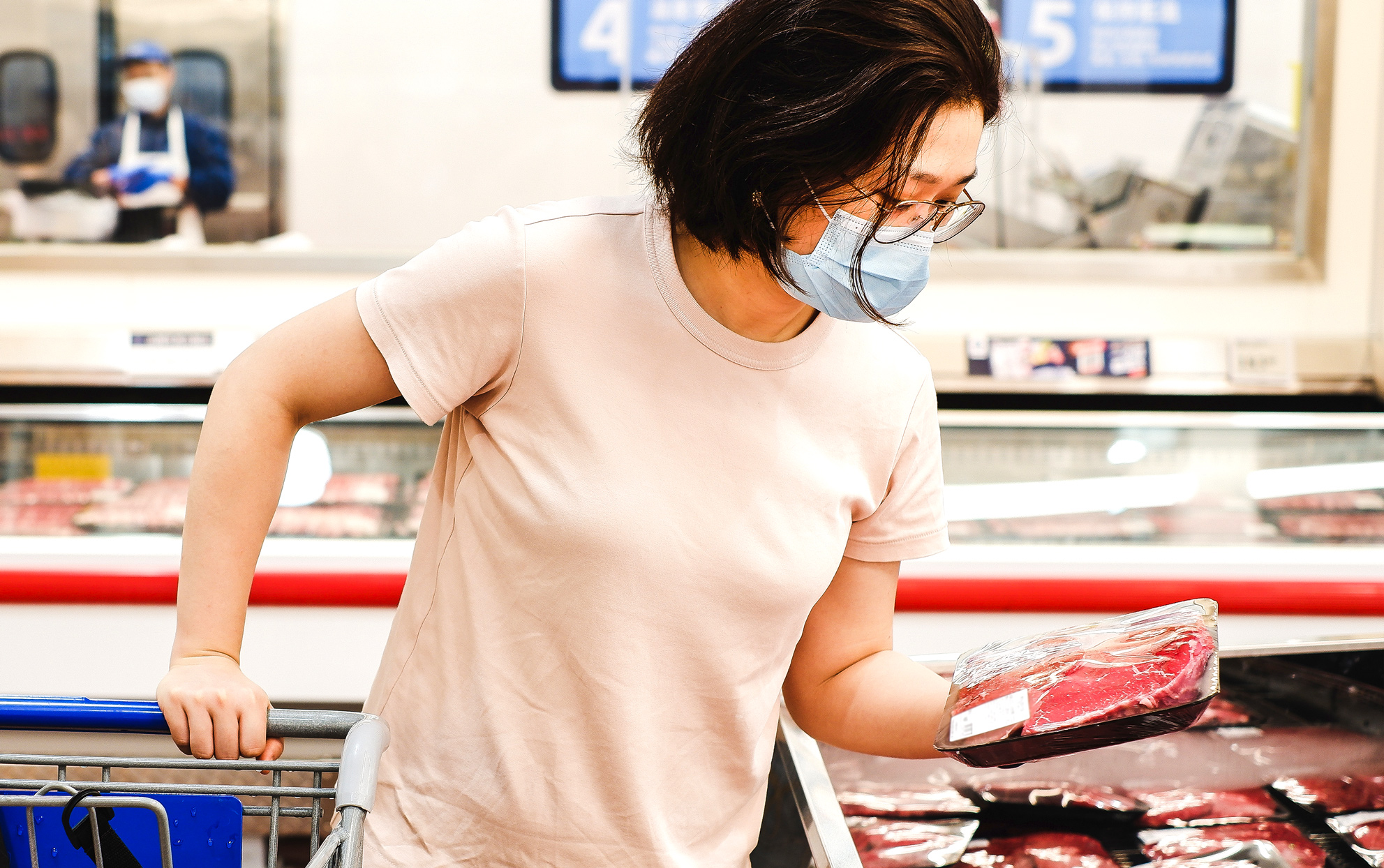 woman shopping with face mask on in grocery store