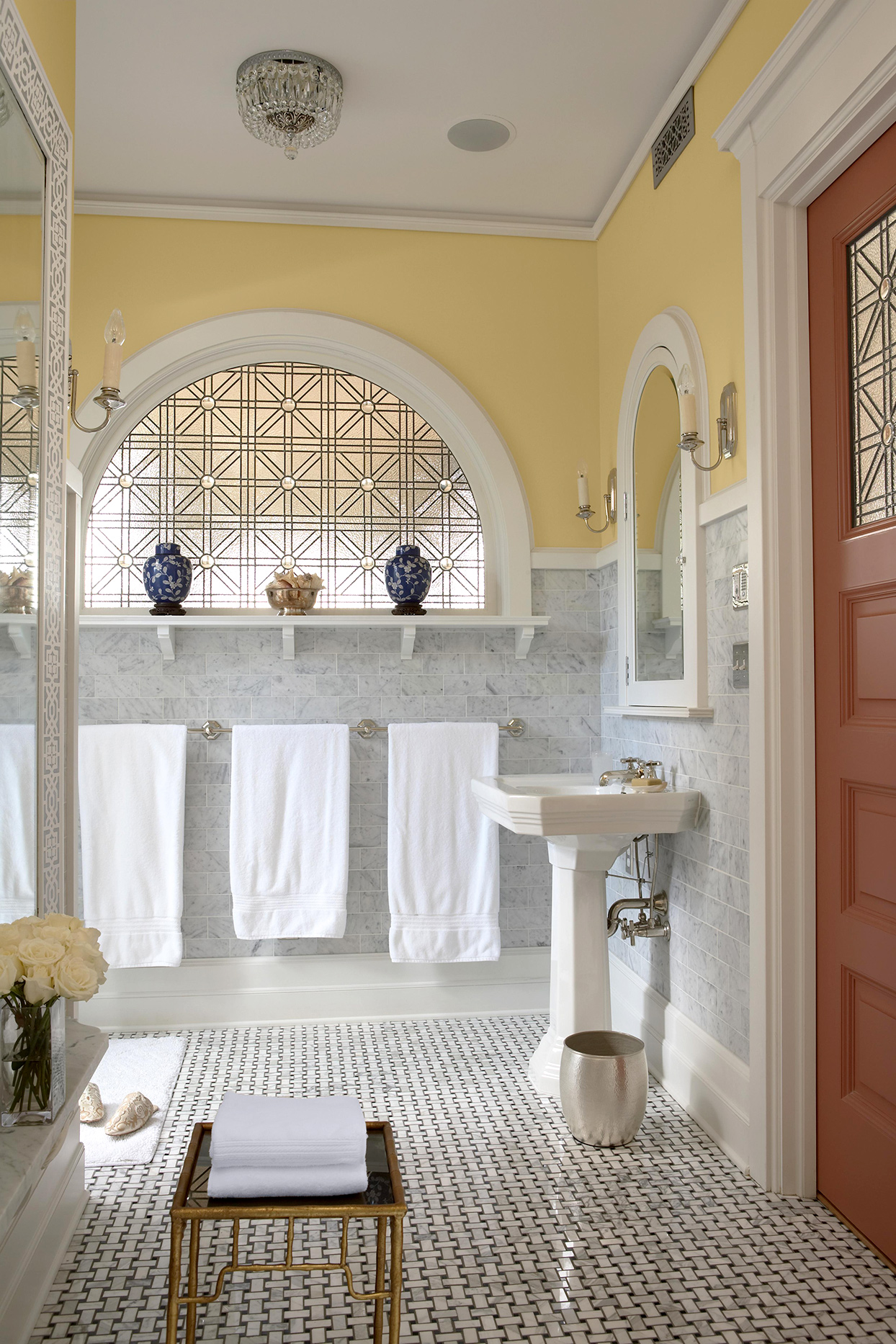 Bathroom with marble and yellow walls