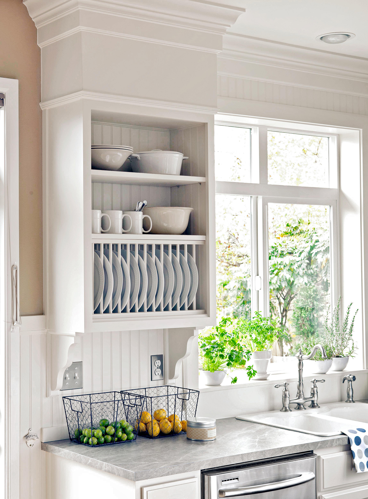 white kitchen with open storage slots for dishes