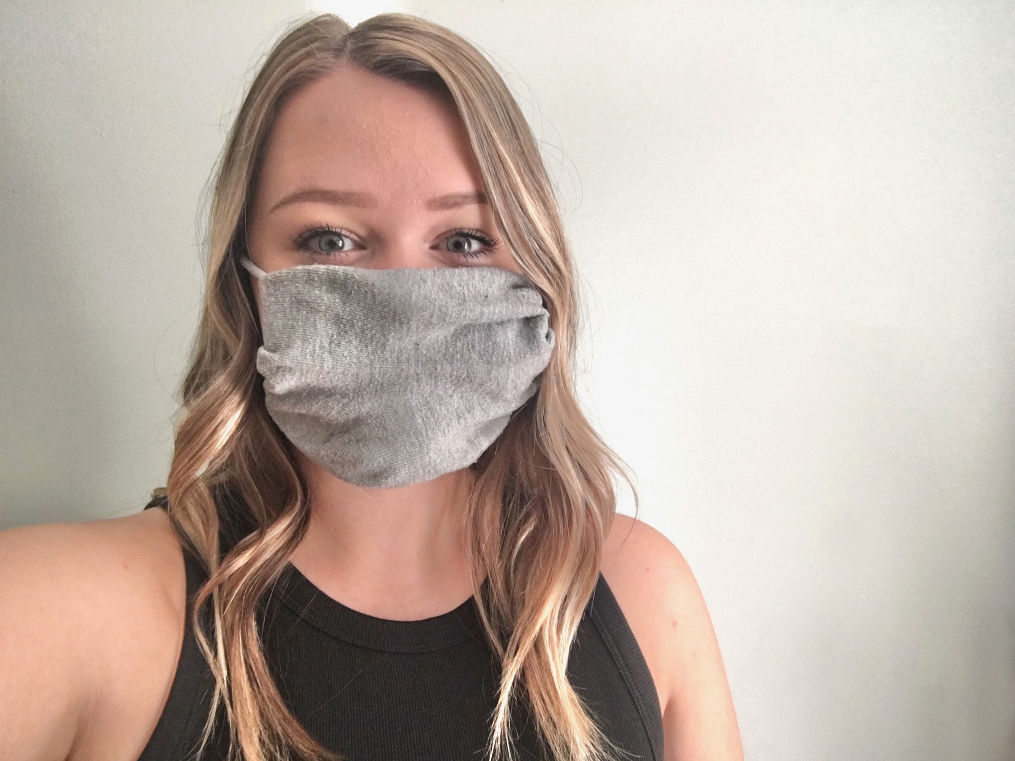 woman wearing sock mask