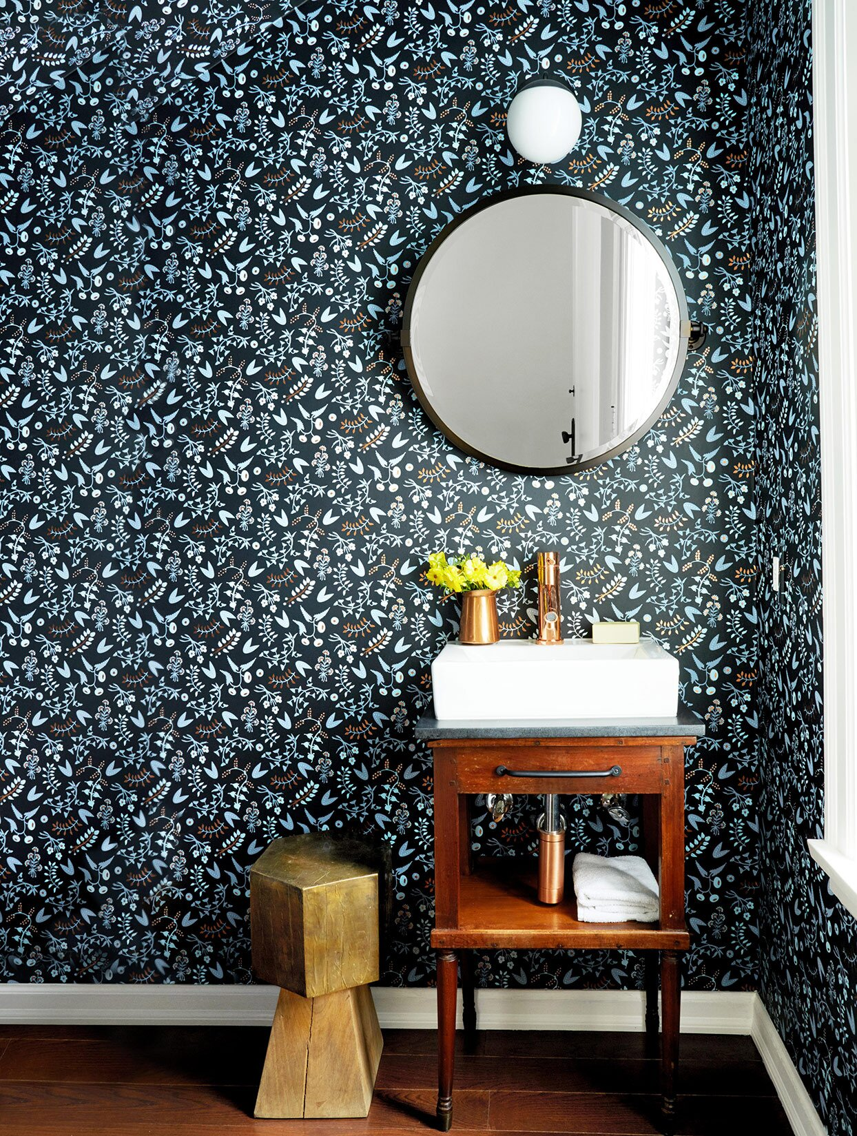 Corner of room with floral wallpaper