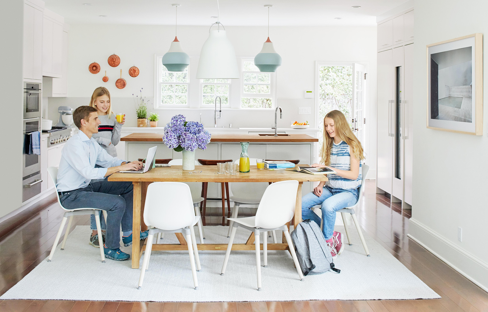 Family sitting at wooden dining table