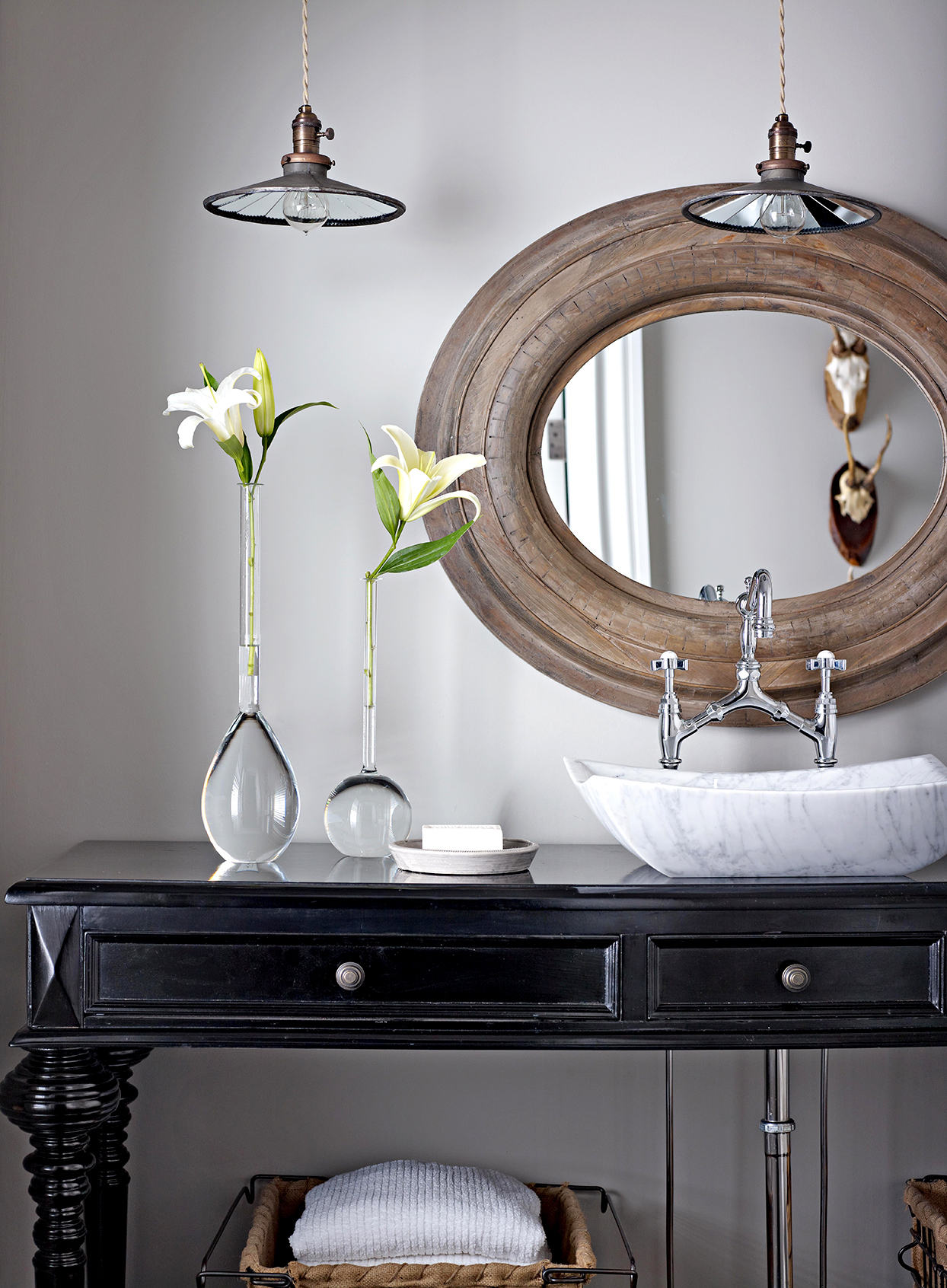 Bathroom with black cabinet and flowers