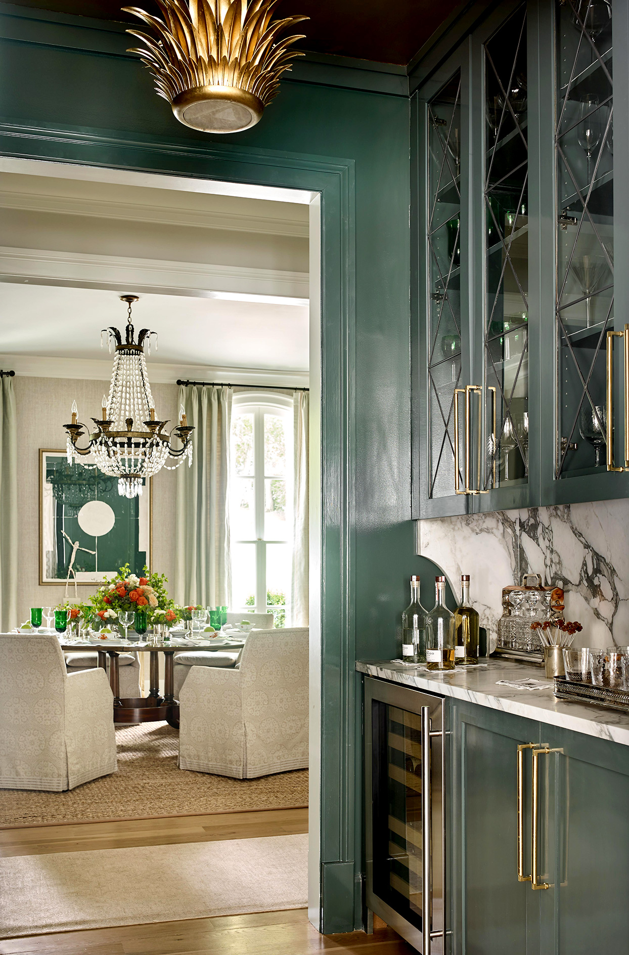 kitchen with green walls and cabinets