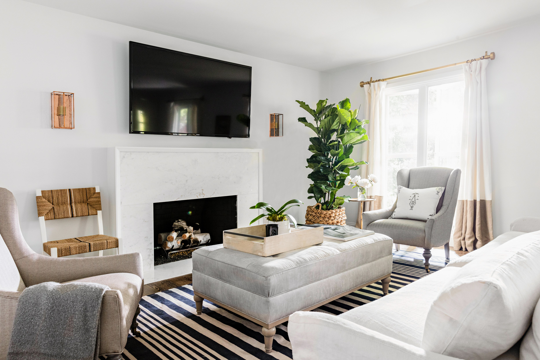 neutral living room white fireplace