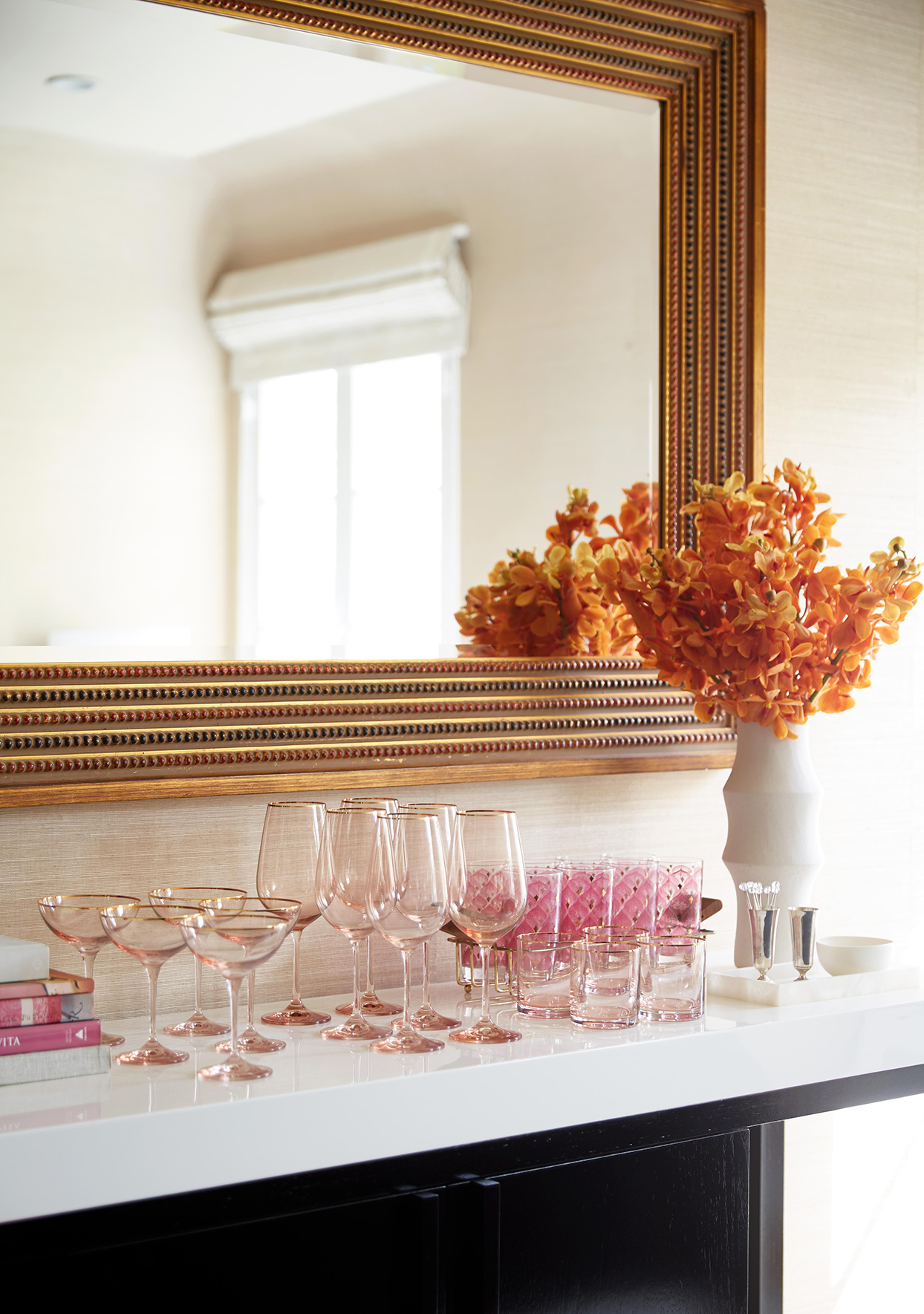 large wall mirror drinking glasses