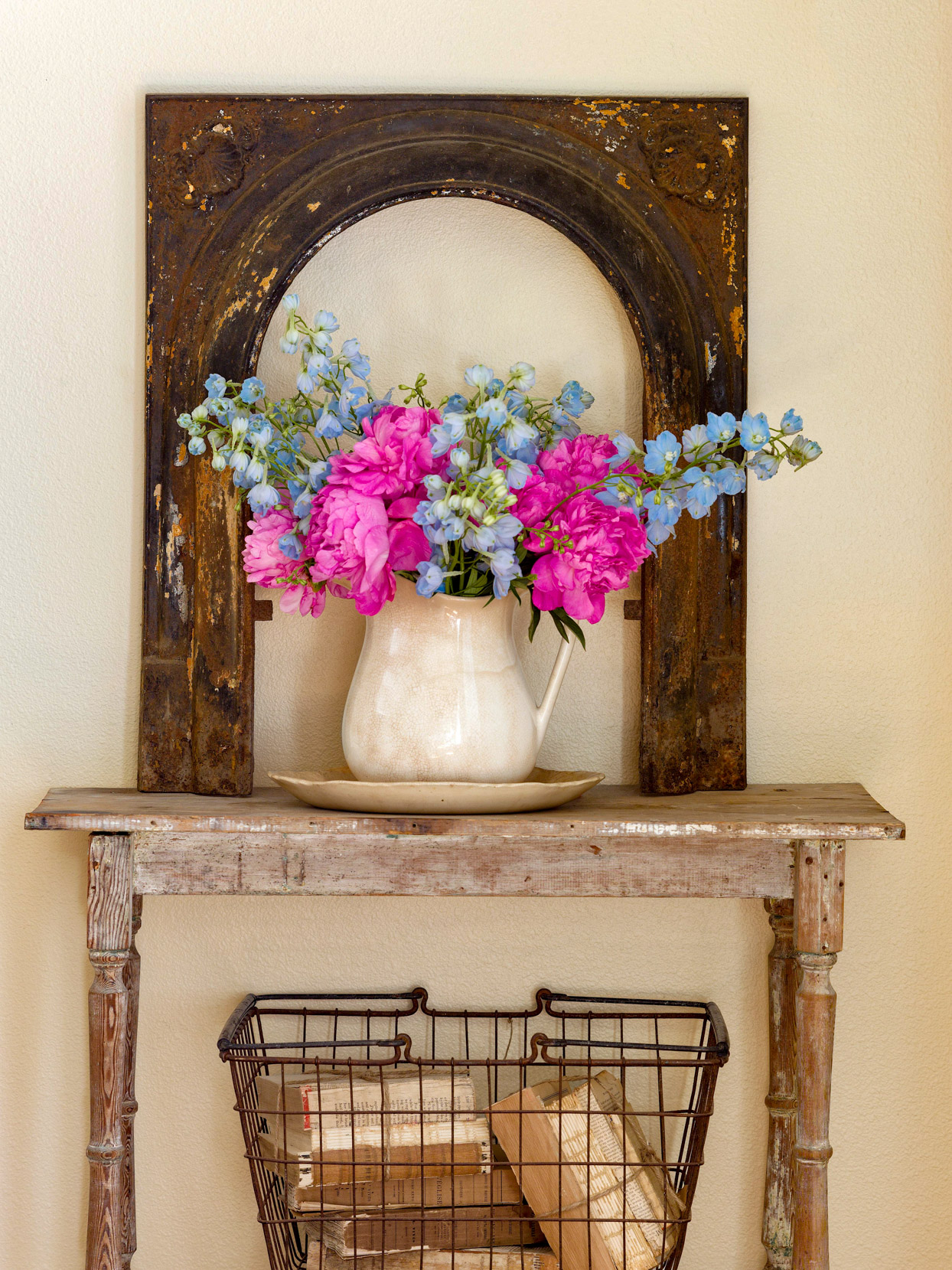rustic antique wooden table and decorative arch with flower bouquet