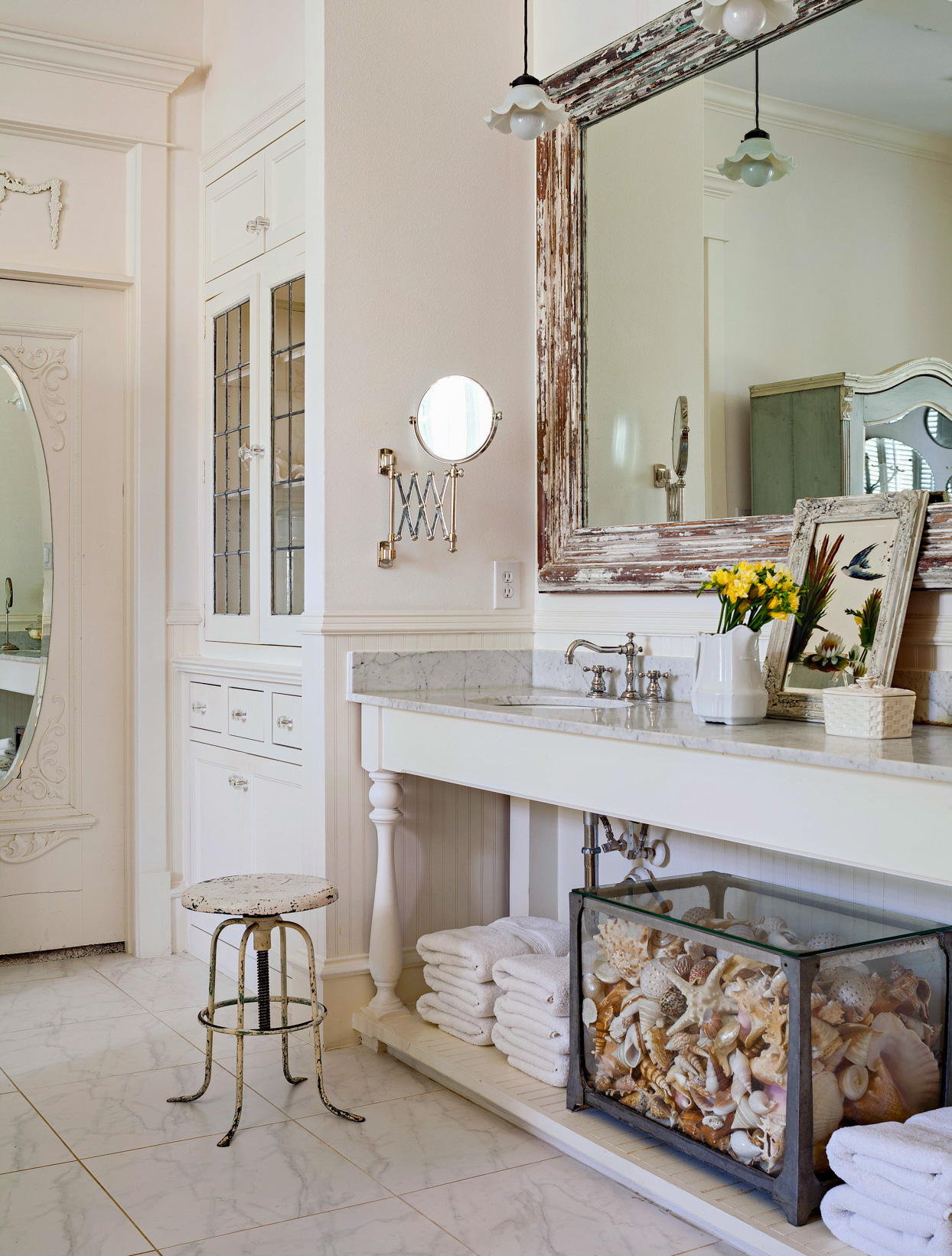 white bathroom with antique mirror frame