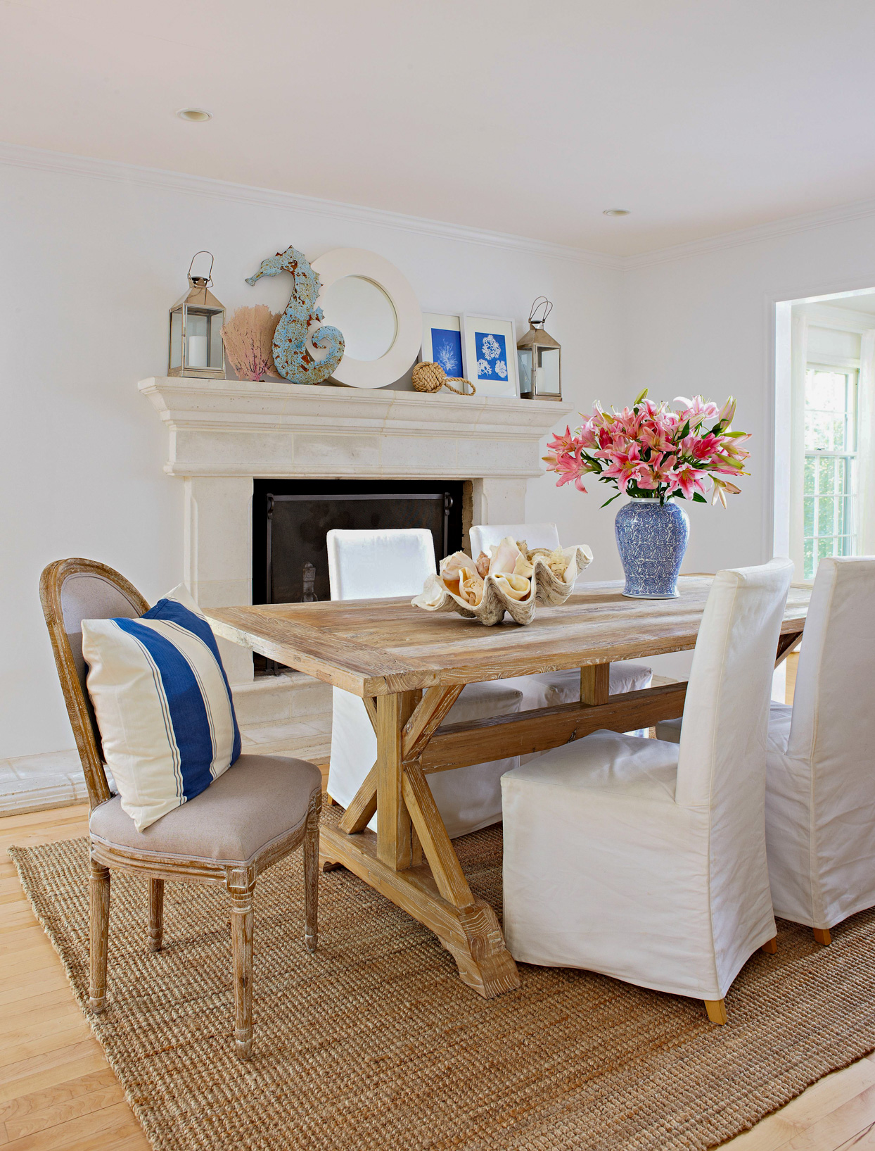 white dining room with blue accents and rustic wooden table