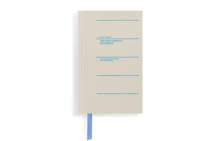 white journal with blue text on the cover