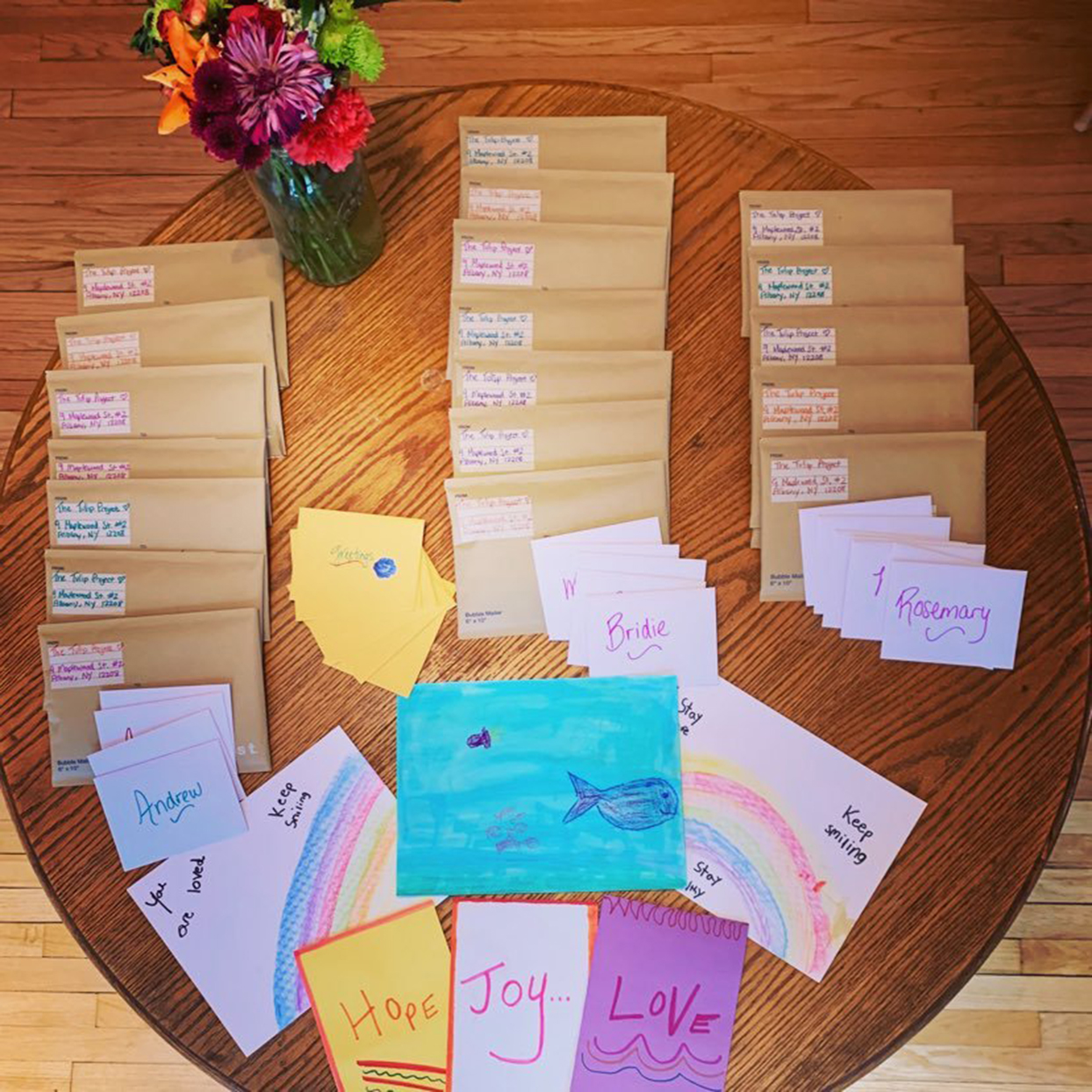 table of envelopes and handmade cards for the tulip project