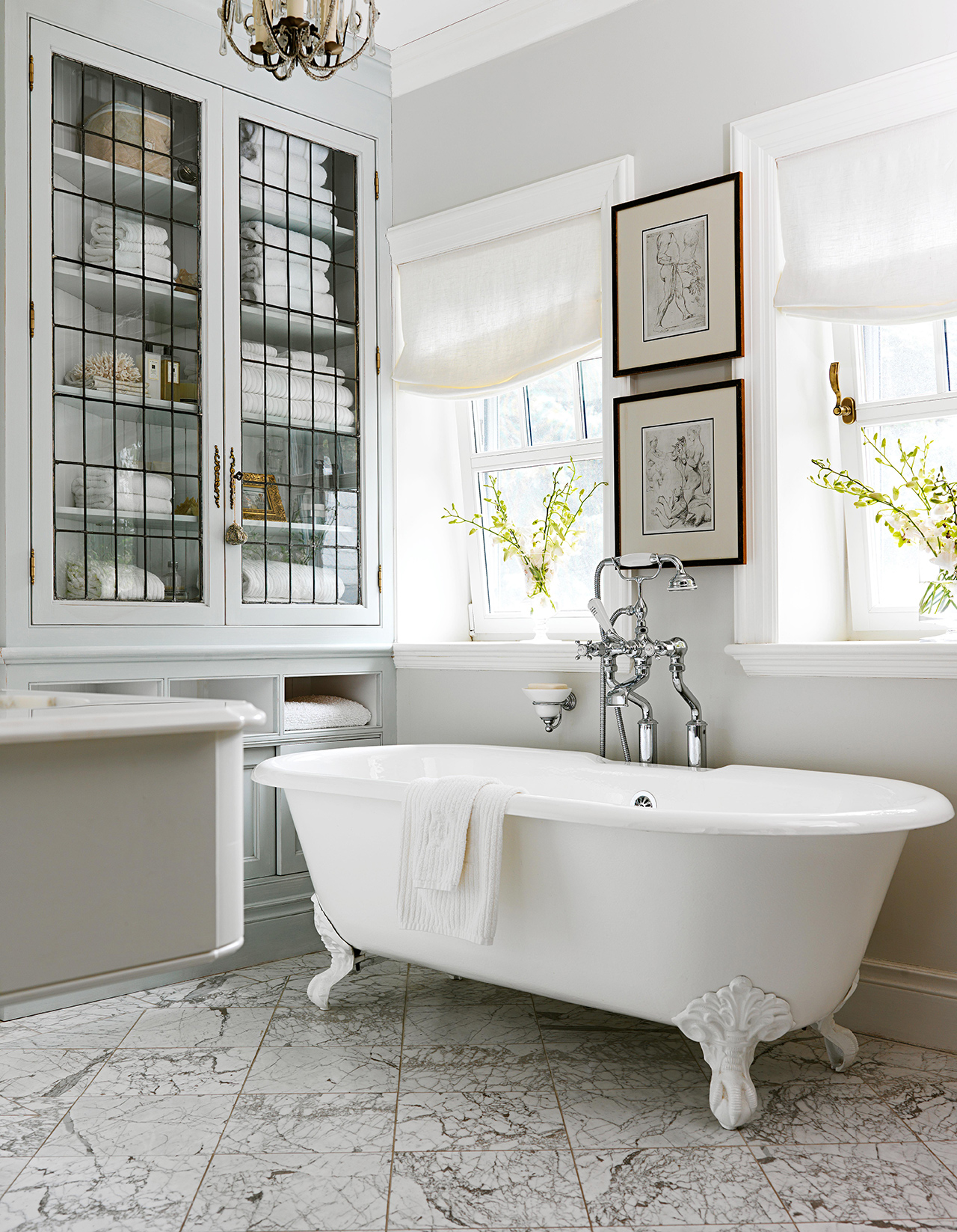 white bathroom black accents leaded glass armoire