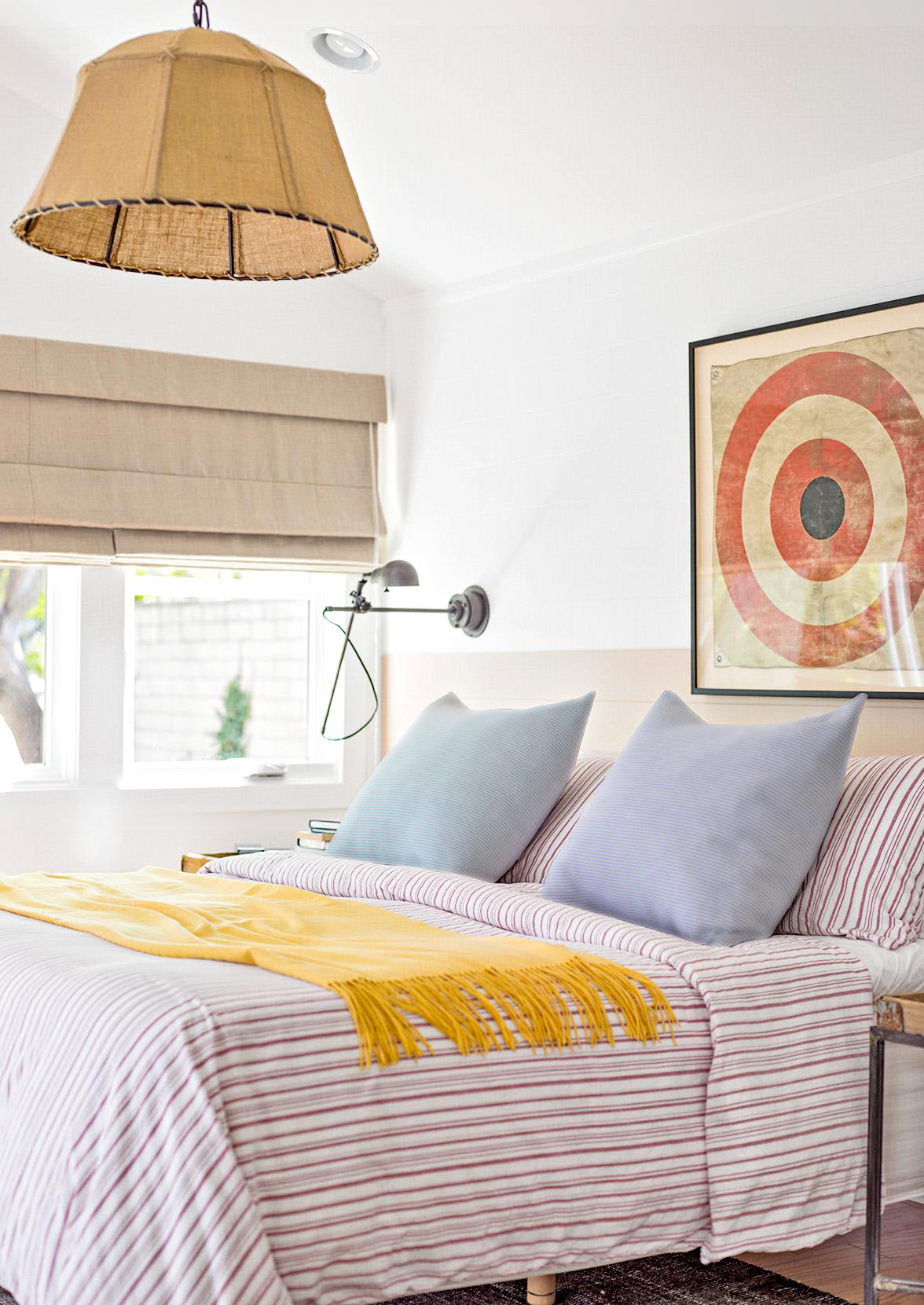 Bedroom with red target artwork above bed