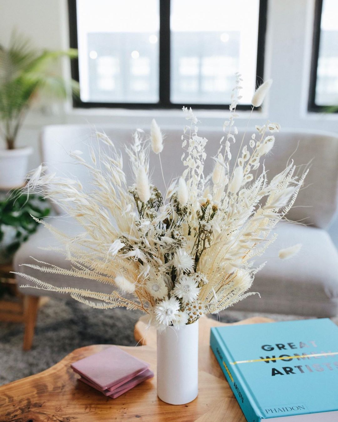 white dried floral bouquet on a table