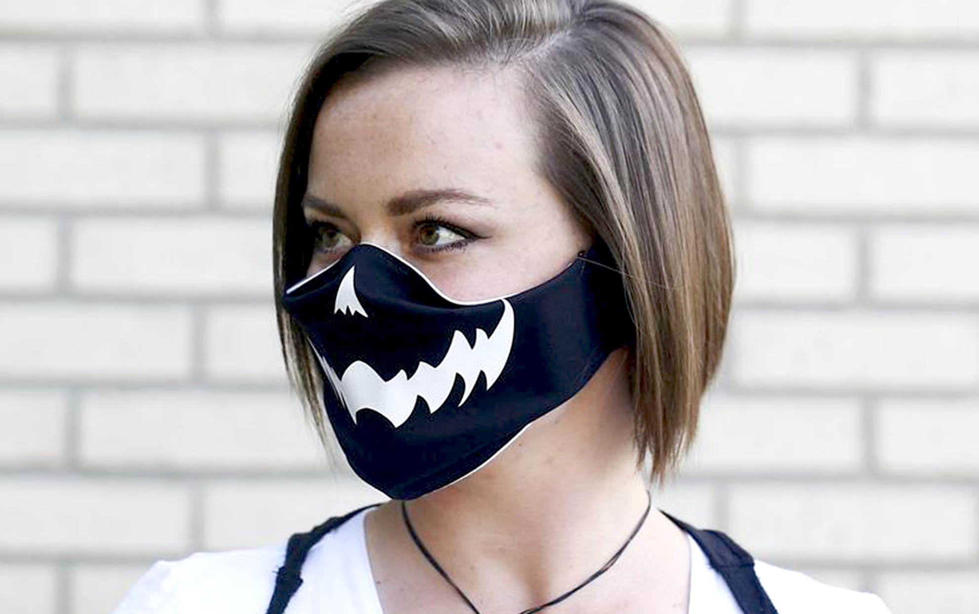 woman wearing a Halloween face mask