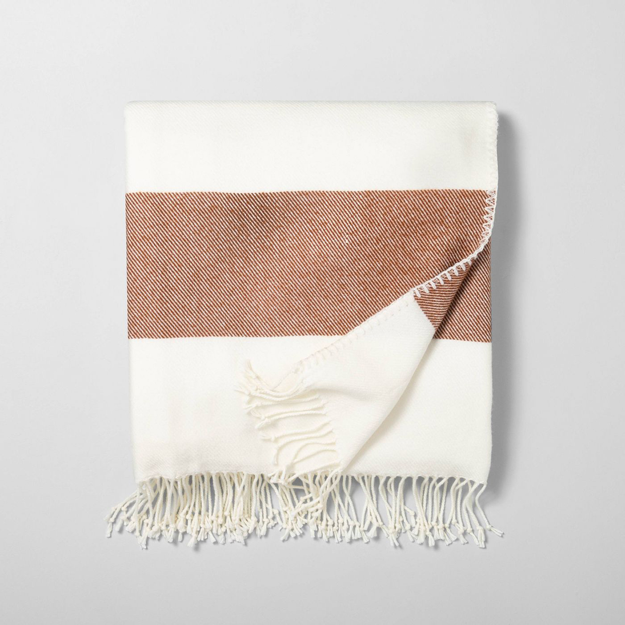 white and brown striped throw