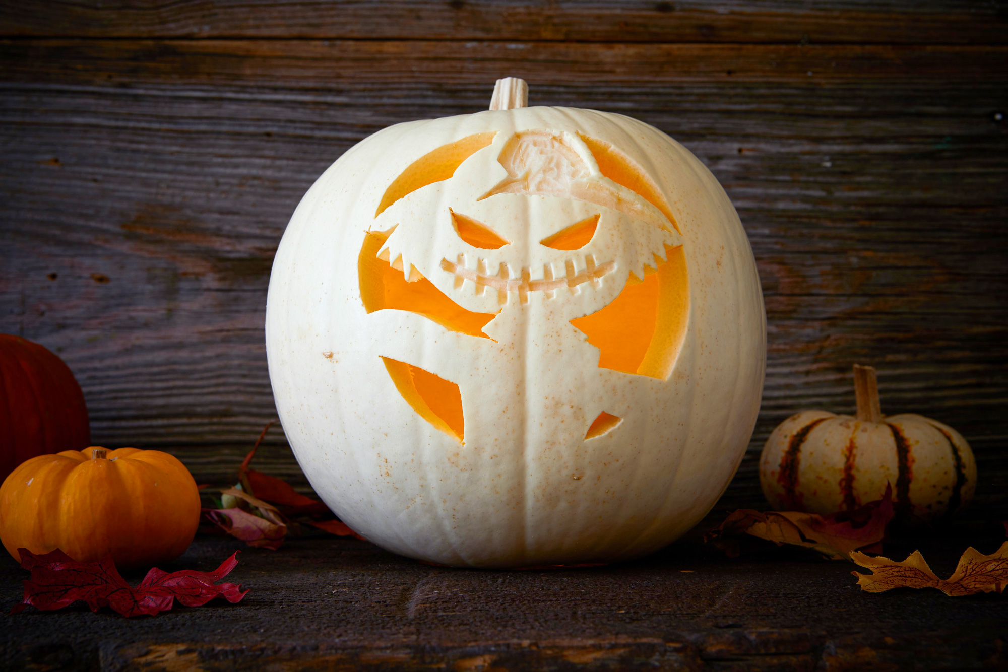 carved pumpkin gremlin with hat
