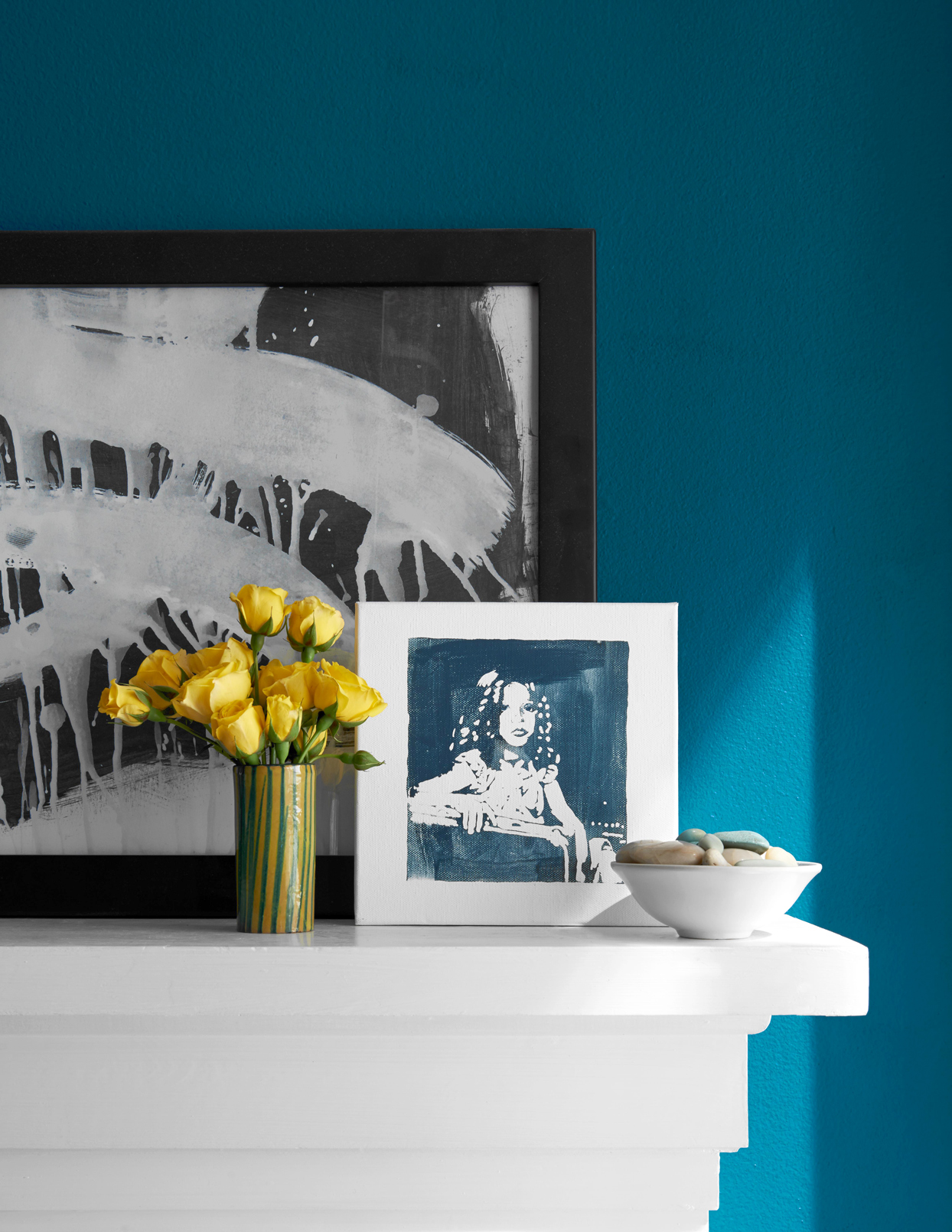 Picture frame by flower vase on mantelpiece