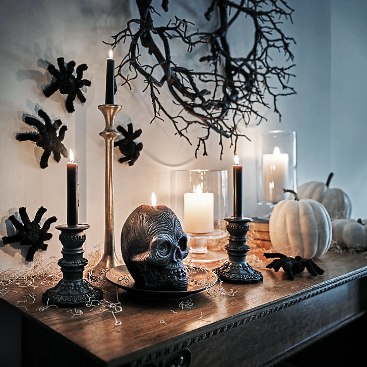 black skull candle and halloween decor