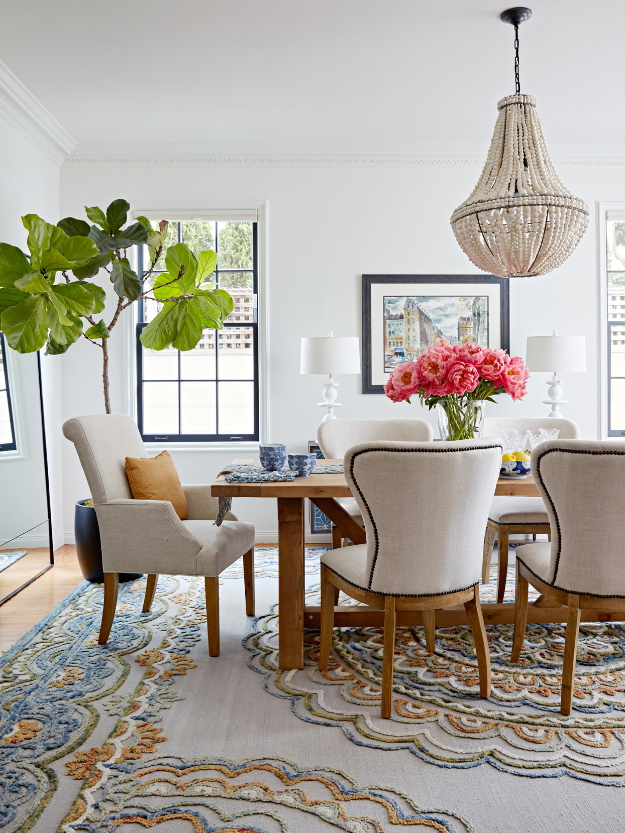 neutral-colored dining room with fiddle leaf fig tree