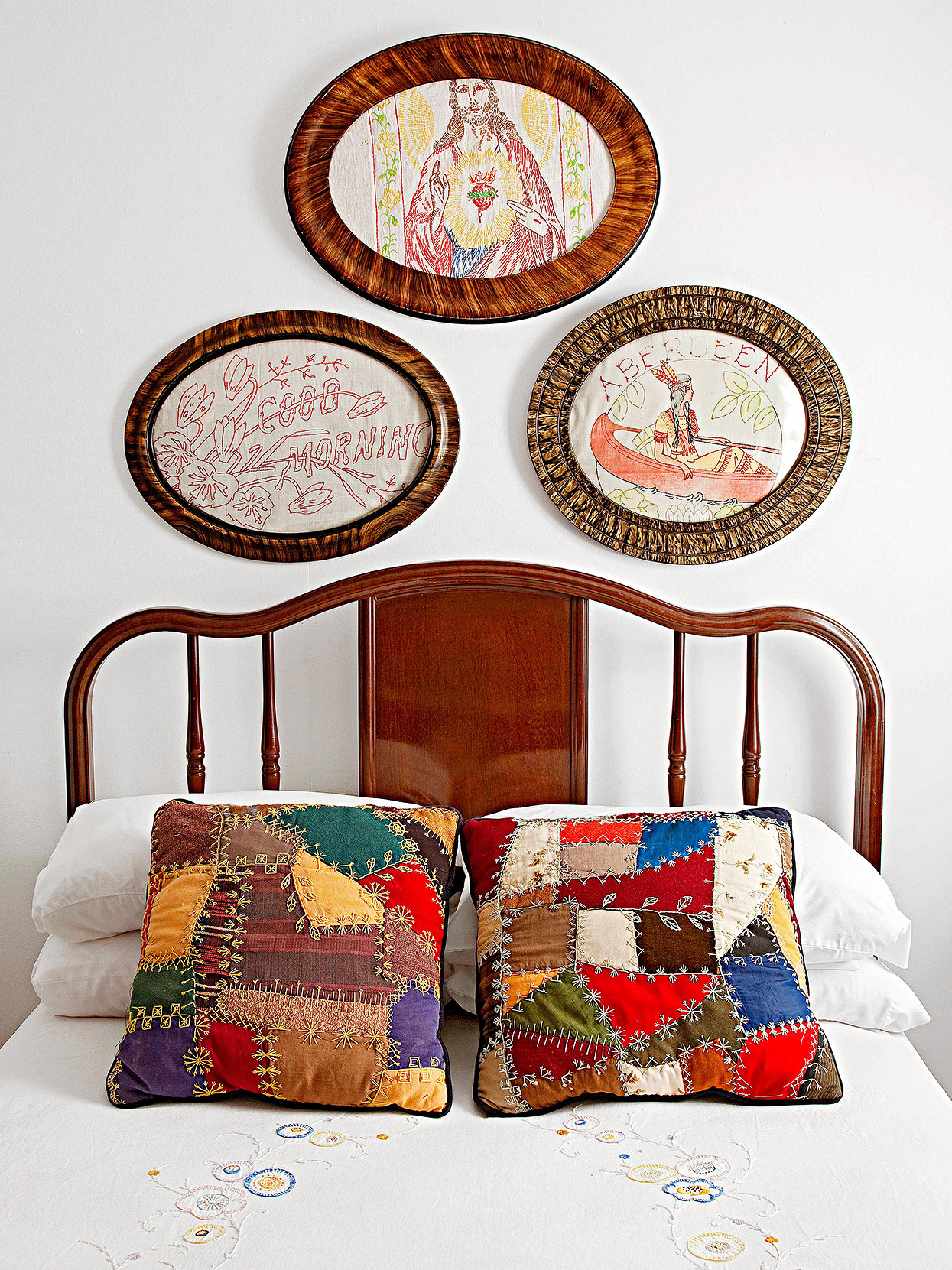 oval framed samplers and quilt accent pillows