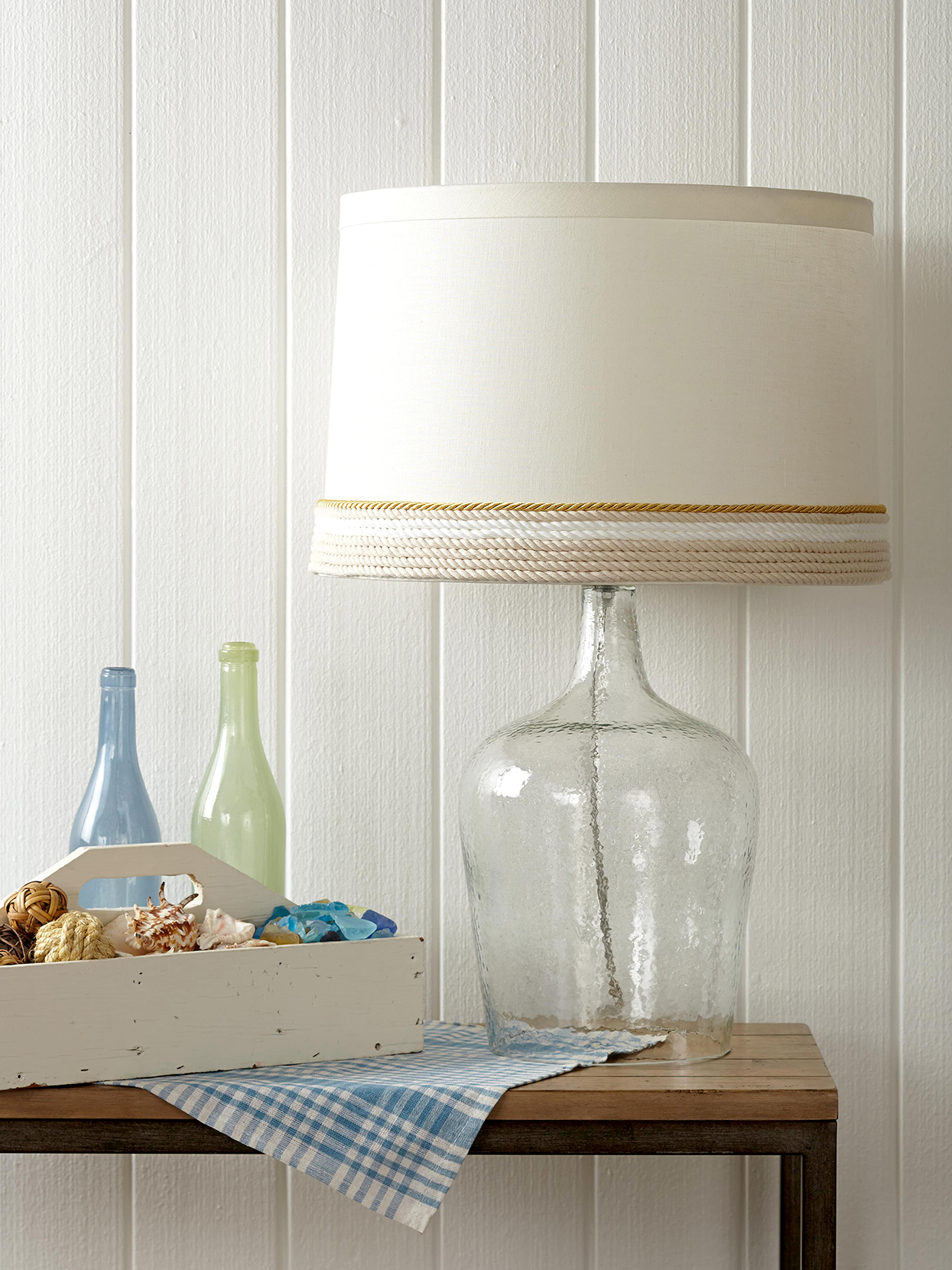rope-wrapped lampshade on table with glass lamp base