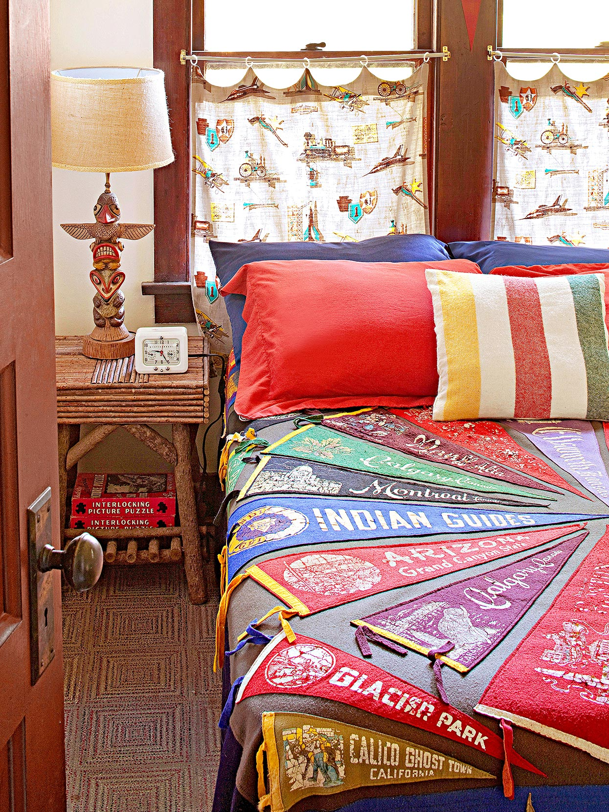 souvenir pennants stitched to quilt in rustic bedroom