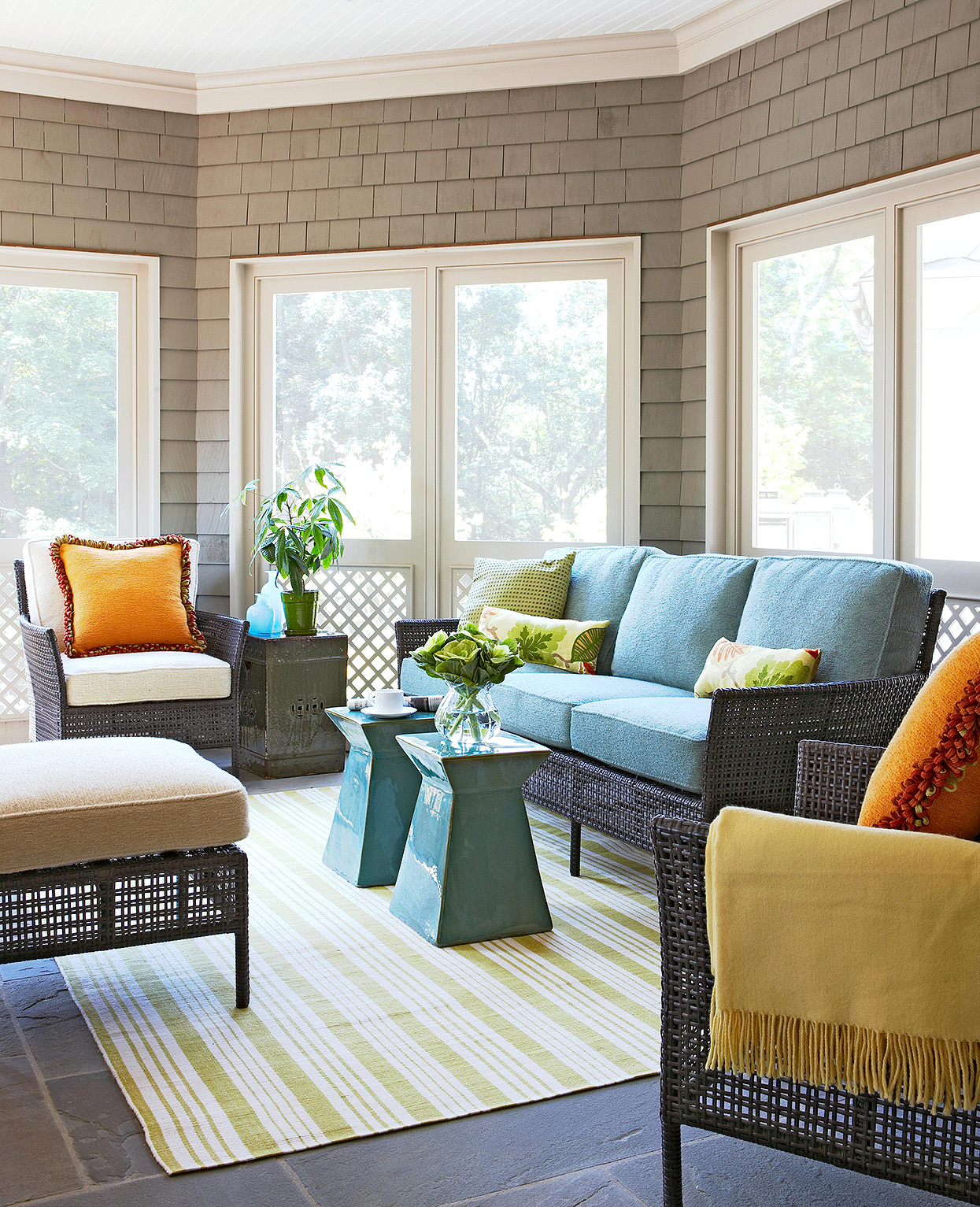modern sunroom with visible shingles and pops of teal and orange