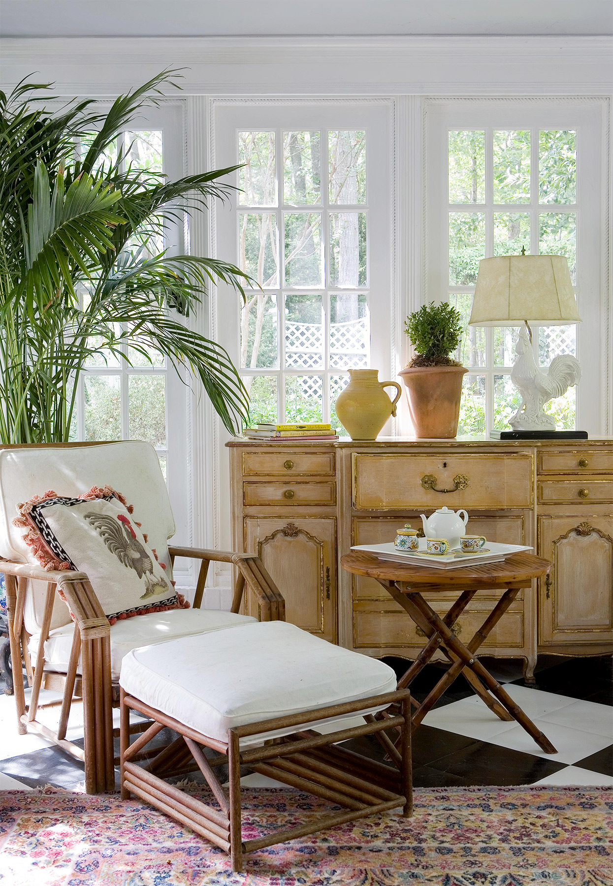 traditional chest and island-inspired seating in sunroom
