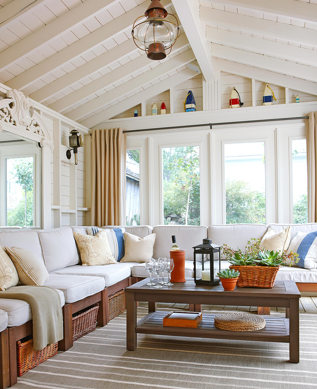 open, vaulted sunroom ceiling and large corner sectional