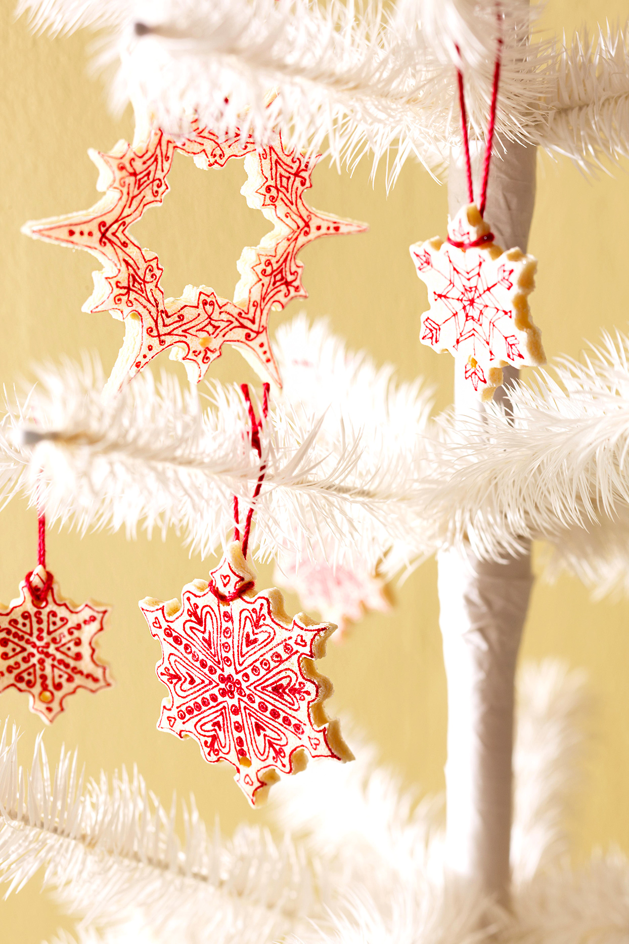 red and white ornaments on tree