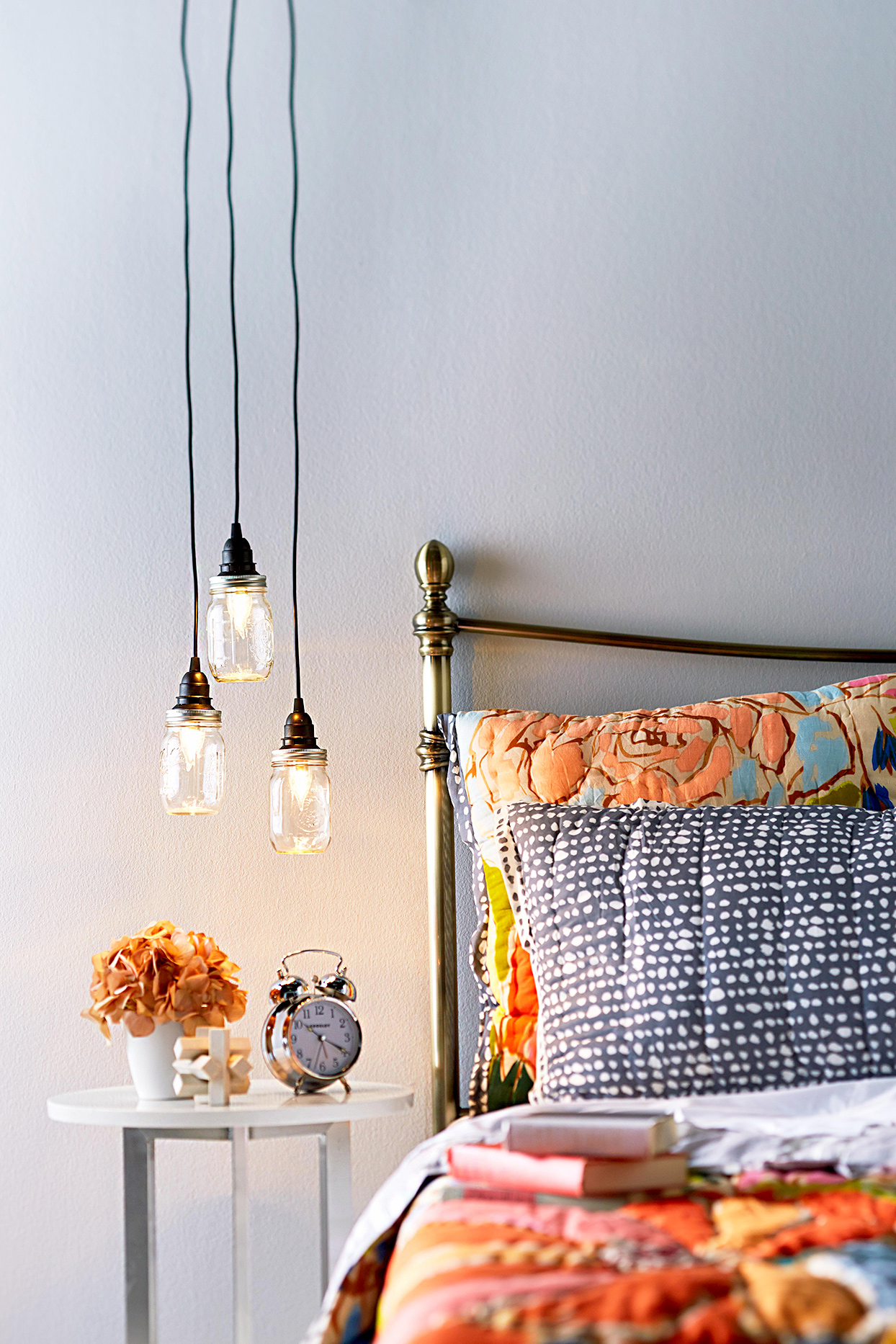 bed with hanging lights