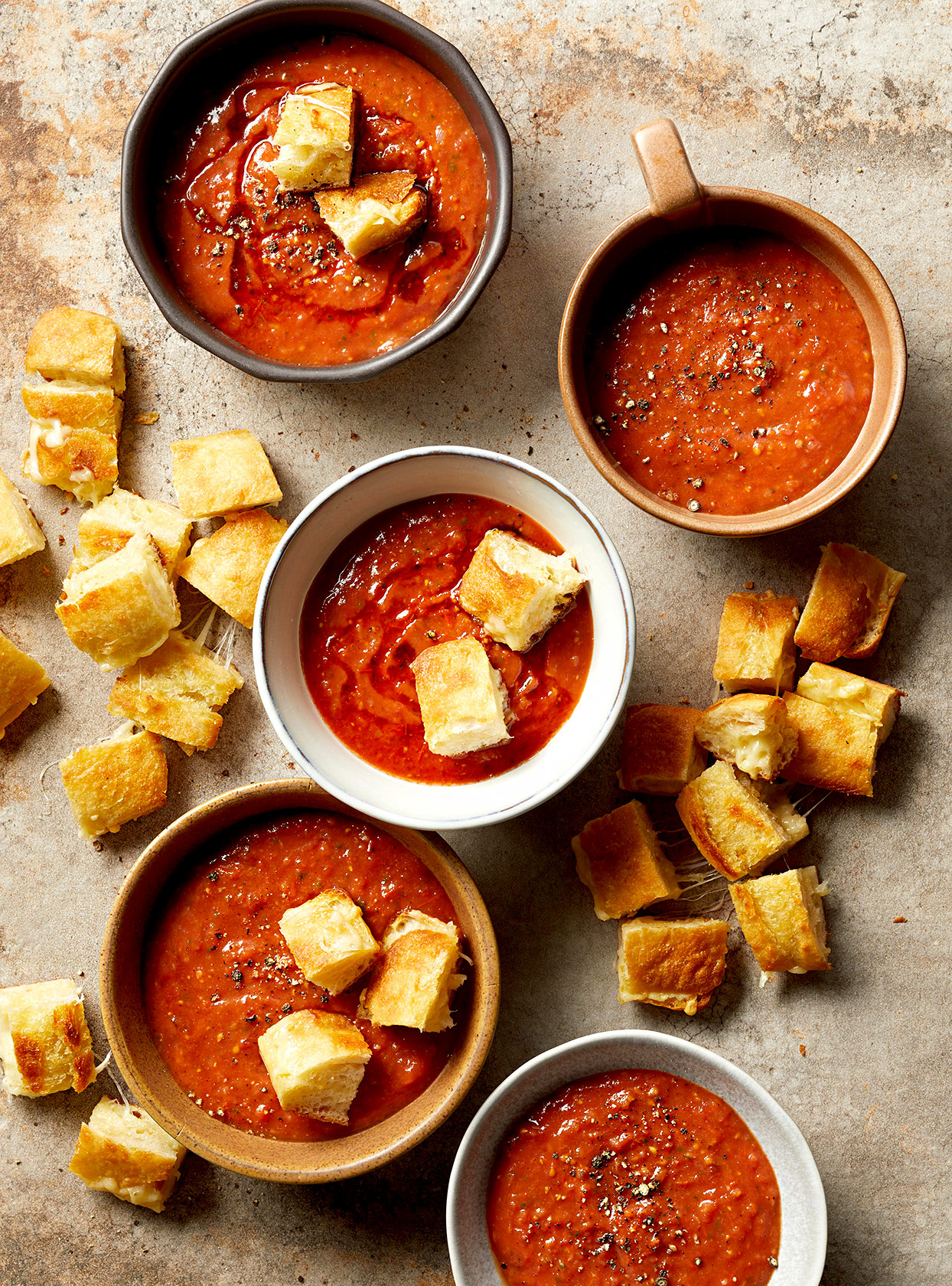 bowls of Fresh Tomato Soup with Grilled Cheese Croutons on sheet pan